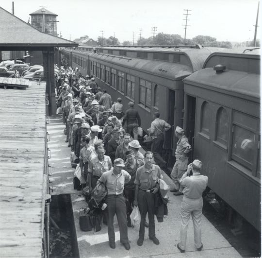 German POWs arrive by train to work in Door County orchards and canneries during World War II.