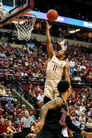 Florida State senior point guard David Nichols (11) scored six points during the Seminoles 78-73 victory over NC State on Saturday.