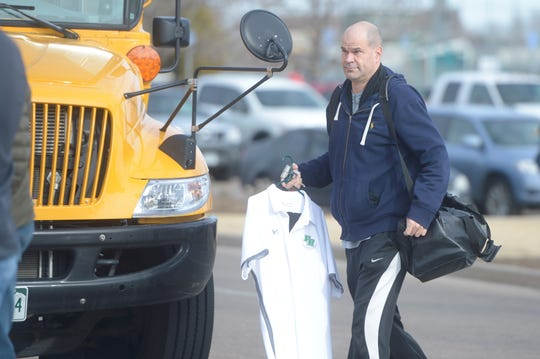 Fossil Ridge assistant coach Jamie Menefee prepares to board the bus to take the basketball team to Denver for Friday's Great Eight game at the Denver Coliseum in March. Menefee has been named head coach to replace the departed Chad Salz.