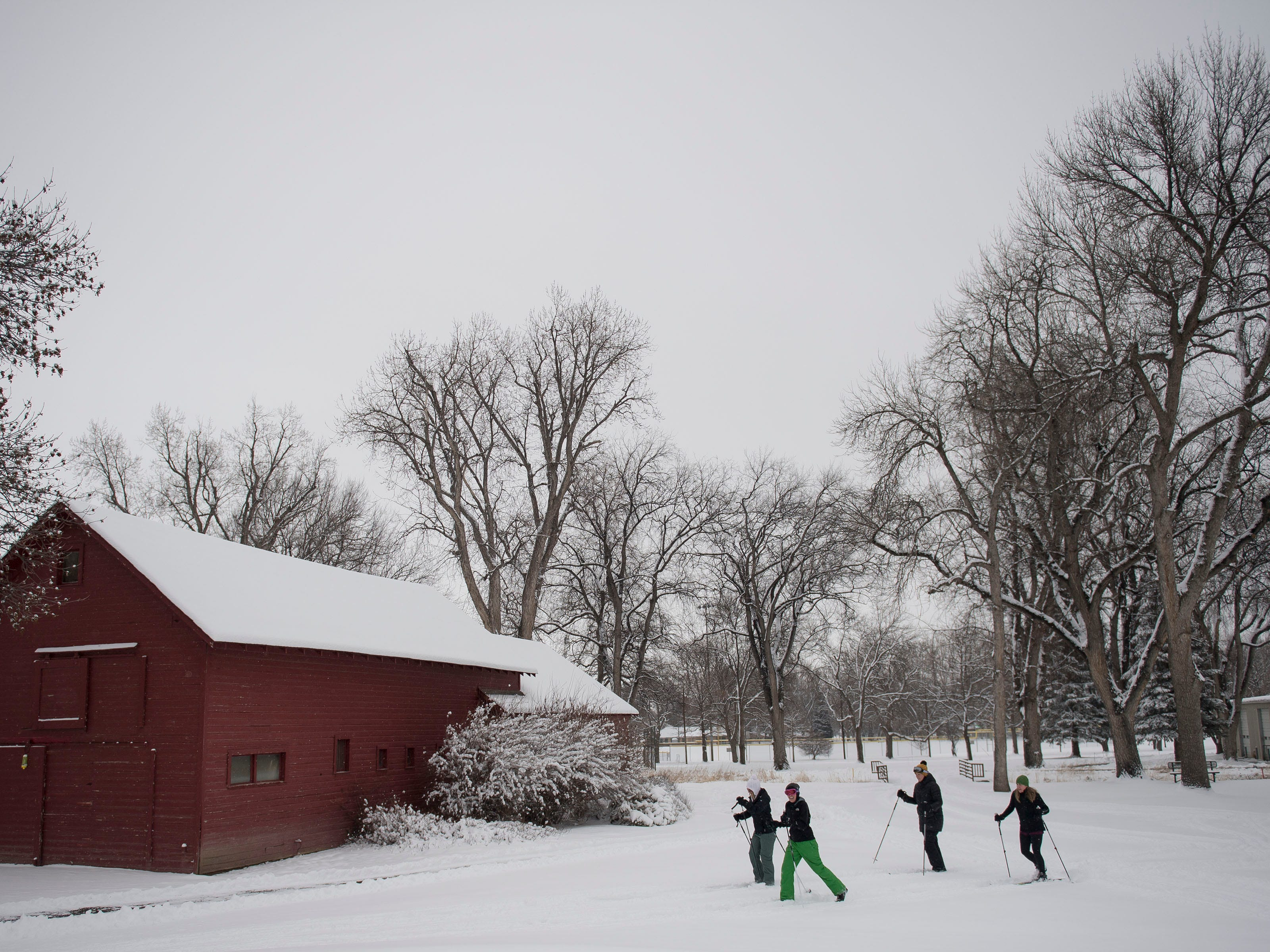 Friends, from left, Katie Kublenz, Megan Haynes, Emily Brockman and Laura Moore cross-country ski through City Park Nine Golf Course on Saturday, March 2, 2019, in Fort Collins, Colo.