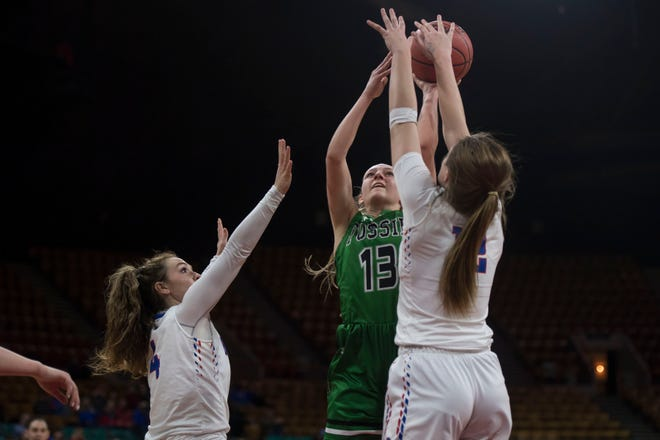 Cherry Creek's Cali Clark, right, blocks a shot in a playoff game against Fossil Ridge on March 1, 2019. Clark has verbally committed to Colorado State.
