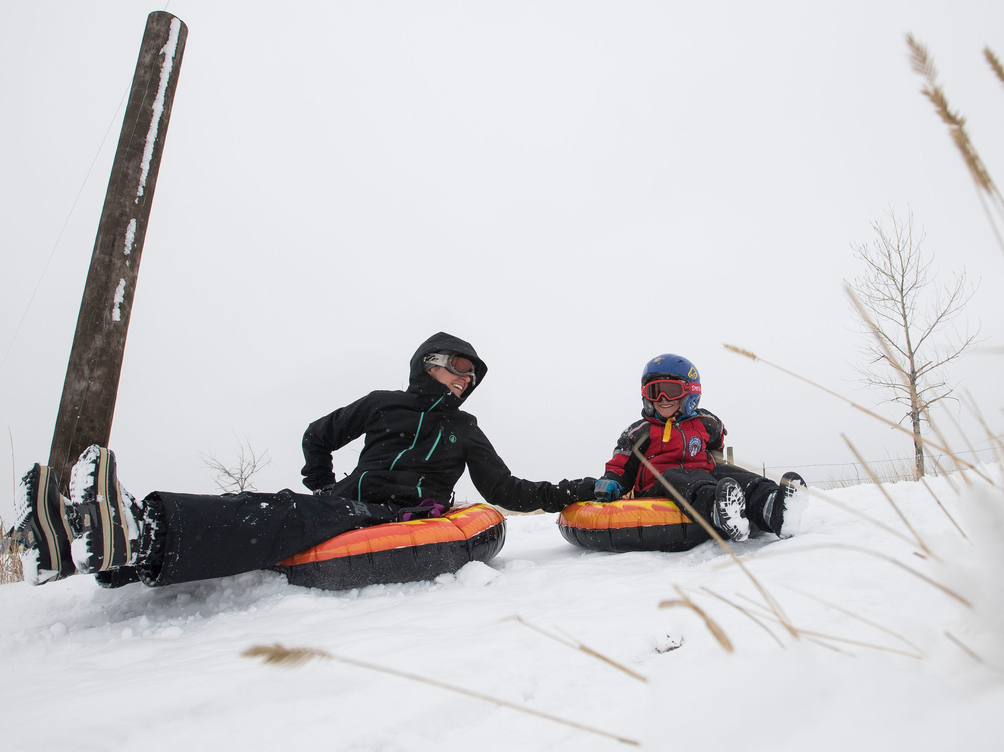 Leslie and Drake VanDerven, 6, take a trip down the hill at the Aggie Greens Disc Golf Course on Saturday, March 2, 2019, in Fort Collins, Colo.