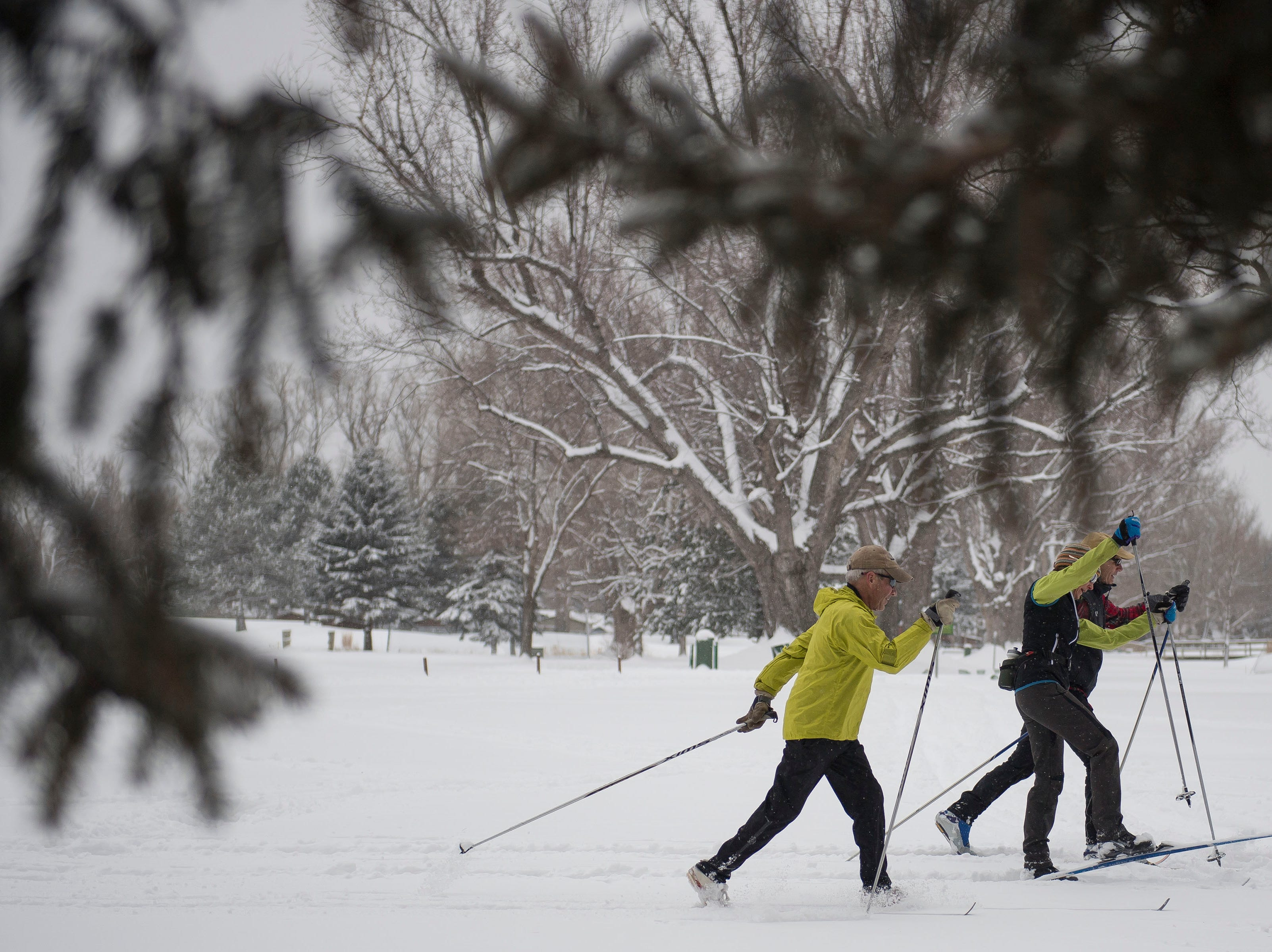 Locals, from left, Doug, Amy, and Jan Hahn cross-country ski through City Park Nine Golf Course on Saturday, March 2, 2019, in Fort Collins, Colo.
