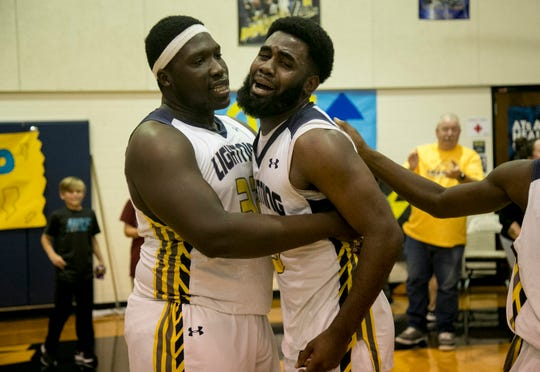 Lehigh Senior High School basketball players Debel Massolas and Delshawn Green celebrate their team's 54-53 win over Port Charlotte in the Class 7A regional final on Friday, March 1, 2019, at Lehigh Senior High School in Lehigh Acres. Lehigh is headed to the state final four.