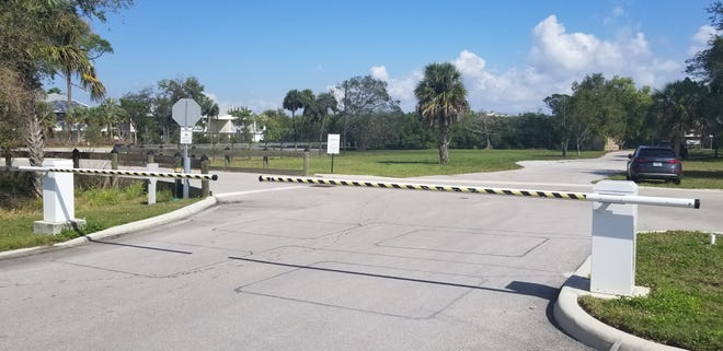 Gated entrance to a boat ramp on Moody Road in North Fort Myers.  Residents of the Moody River Estates community on Hancock Bridge Parkway have the right to use the ramp, but the property owner has offered to give it to Lee County.  Condominium owners are worried that turning the ramp they consider an amenity into a public boat ramp will diminish the value of their property.