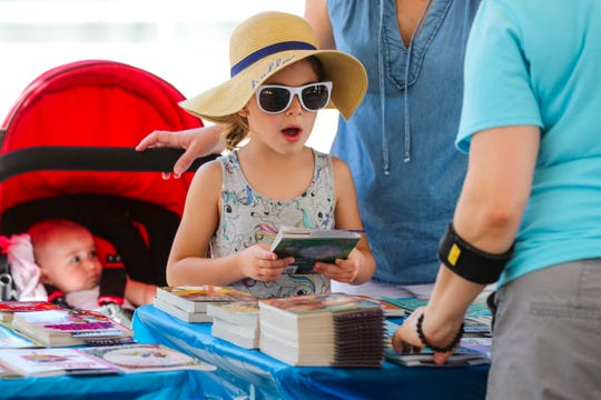 Nikolina Vujaklija, 6, of Fort Myers was in awe of all the books she could pick from last year at the reading fest's free book table.
