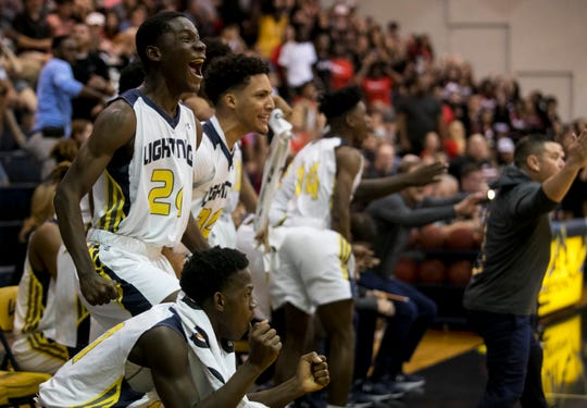 Lehigh Senior High School basketball players celebrate taking the lead over Port Charlotte in the Class 7A regional final on Friday, March 1. Lehigh faces Crestview in a state semifinal at 10 a.m. Friday in Lakeland.