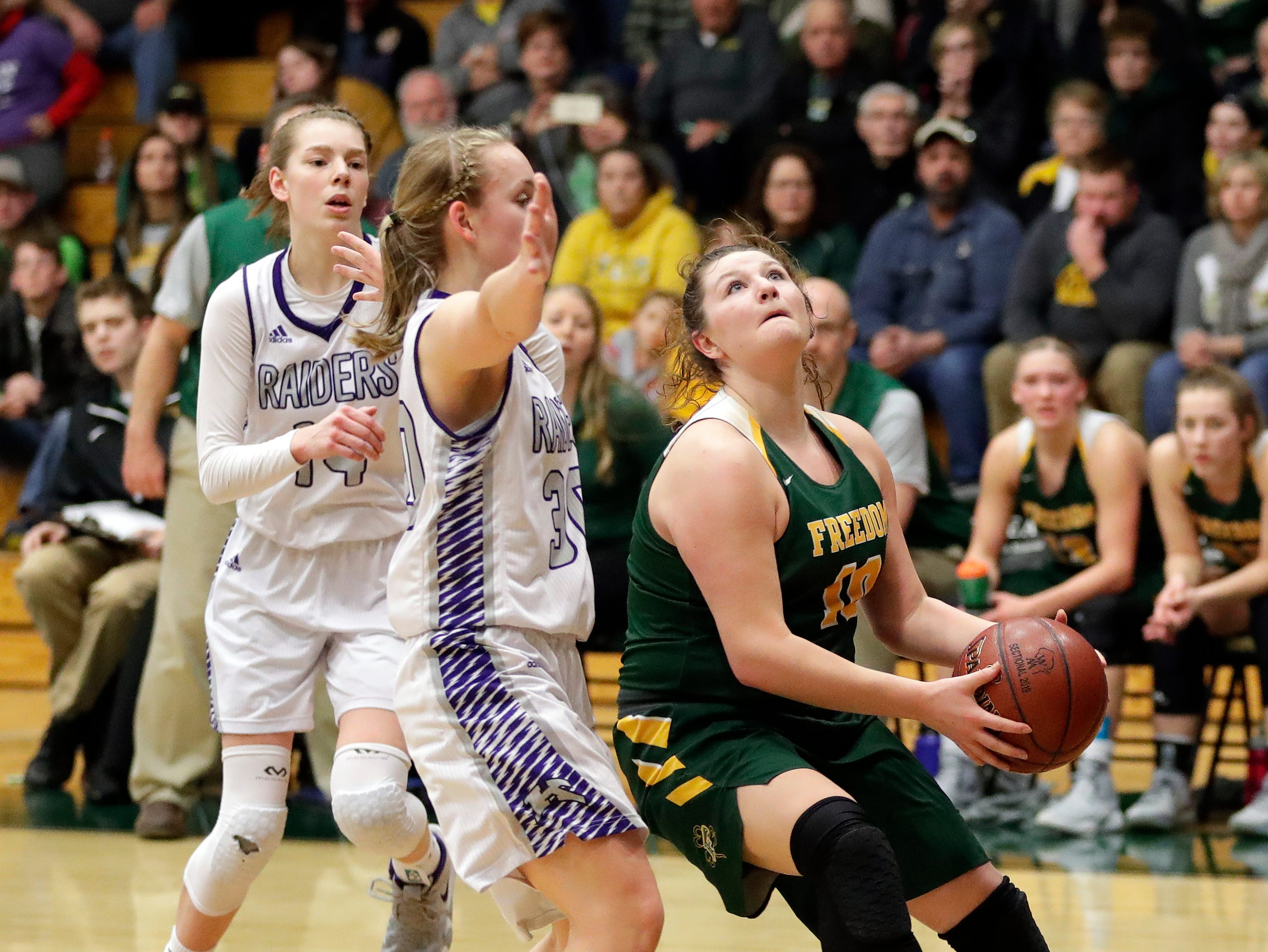 Freedom's Cameron Evers goes in for a basket during a WIAA Division 3 girls basketball sectional championship against Kiel held March 2, 2019 at Ashwaubenon High School. Freedom defeated Kiel 53-40.