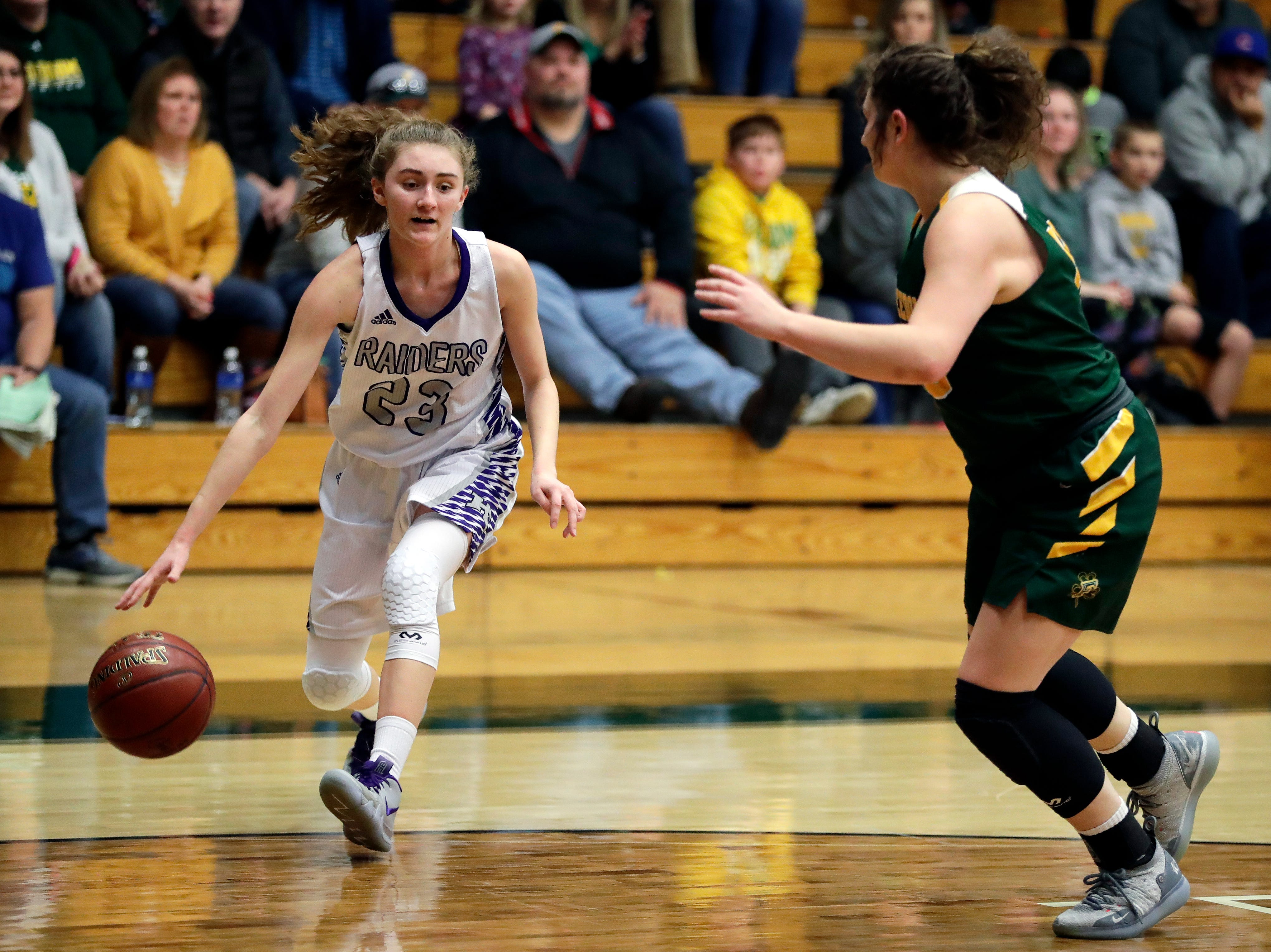Kiel's Jocelyn April (23) tries to get past an opponent during a WIAA Division 3 girls basketball sectional championship against Freedom held March 2, 2019 at Ashwaubenon High School.