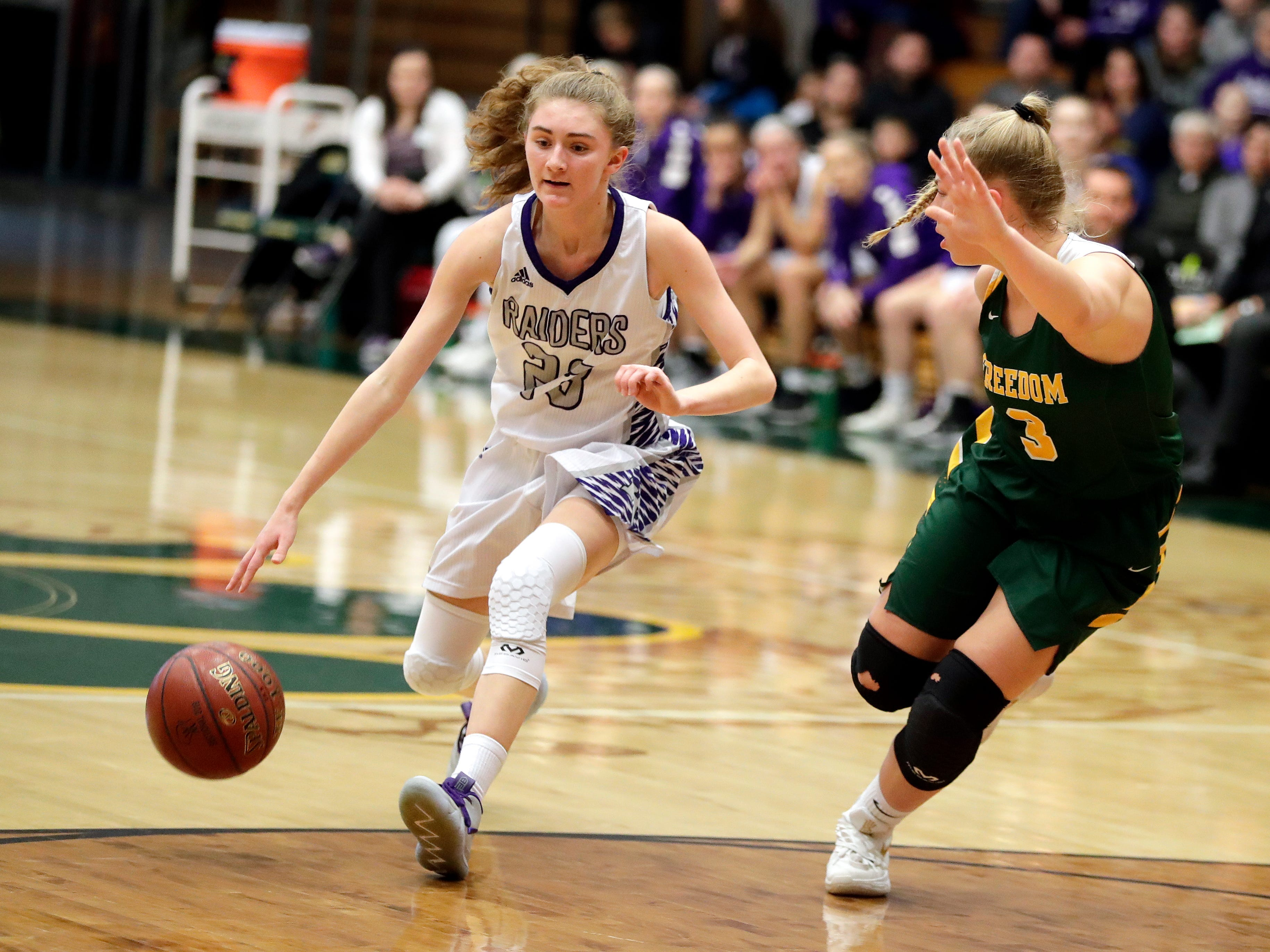 Kiel's Jocelyn Aprill (23) goes against an opponent during a WIAA Division 3 girls basketball sectional championship against Freedom held March 2, 2019 at Ashwaubenon High School. Freedom defeated Kiel 53-40.