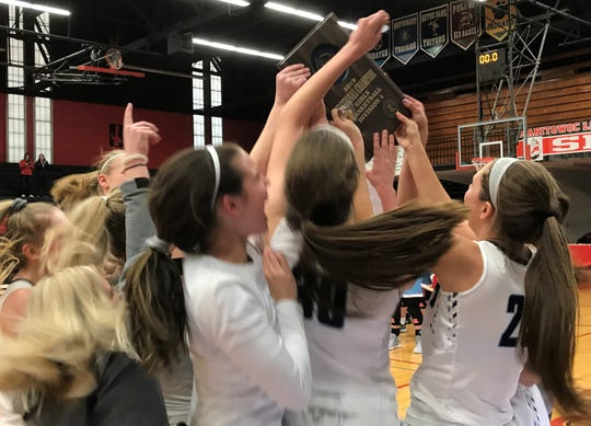 The Bay Port girls basketball team celebrates its WIAA sectional final victory over Arrowhead on Saturday at Manitowoc.