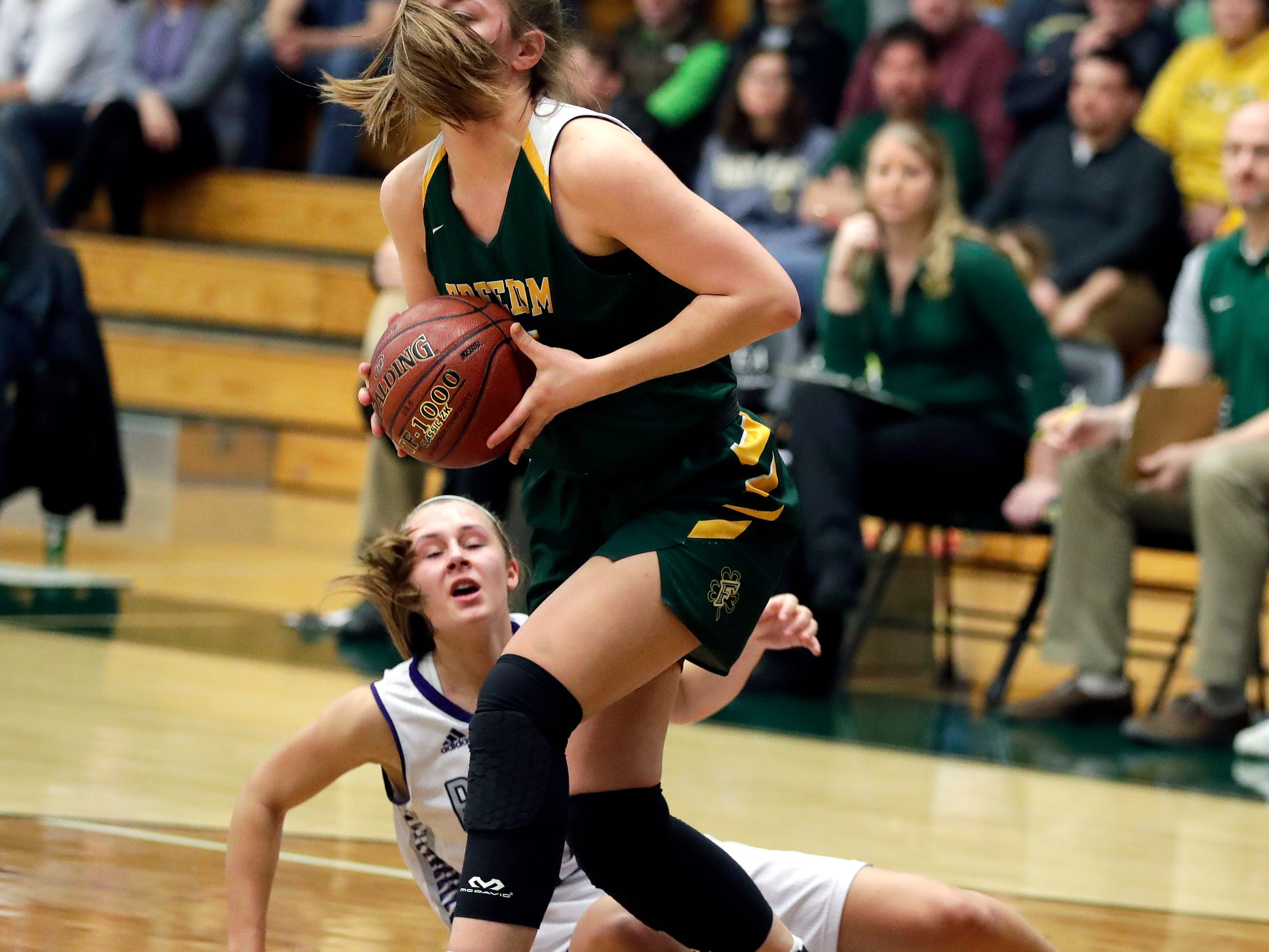 Freedom's Taylor Haase (22) keeps the ball away from an opponent during a WIAA Division 3 girls basketball sectional championship March 2, 2019 at Ashwaubenon High School. Freedom defeated Kiel 53-40.