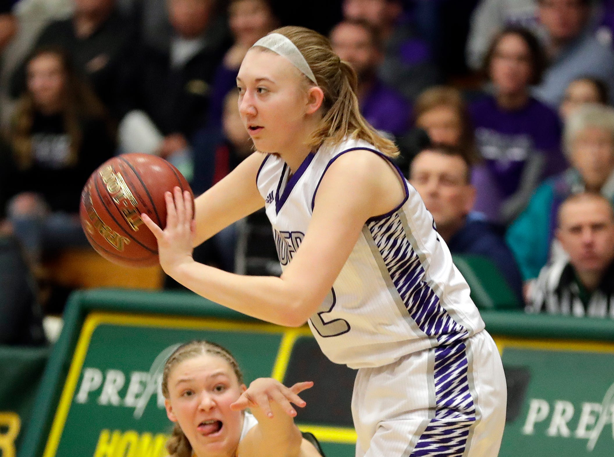 Kiel's Rachel Muehlbauer (32) keeps the ball away from an opponent during a WIAA Division 3 girls basketball sectional championship against Freedom on March 2, 2019 at Ashwaubenon High School.  Freedom defeated Kiel 53-40.
