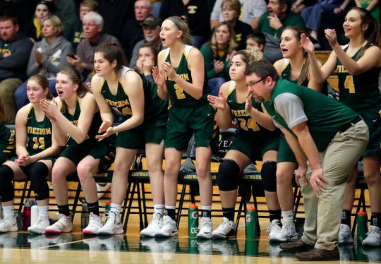 Freedom girls basketball players cheer on their teammates during a WIAA Division 3 girls basketball sectional championship against Kiel held March 2, 2019 at Ashwaubenon High School. Freedom defeated Kiel 53-40.