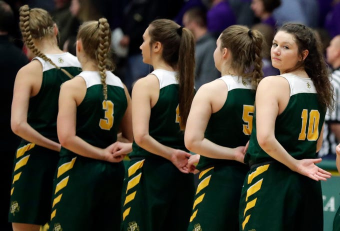 The Freedom girls basketball team lines up for the National Anthem before the start of a WIAA Division 3 sectional championship against Kiel held March 2, 2019, at Ashwaubenon High School.