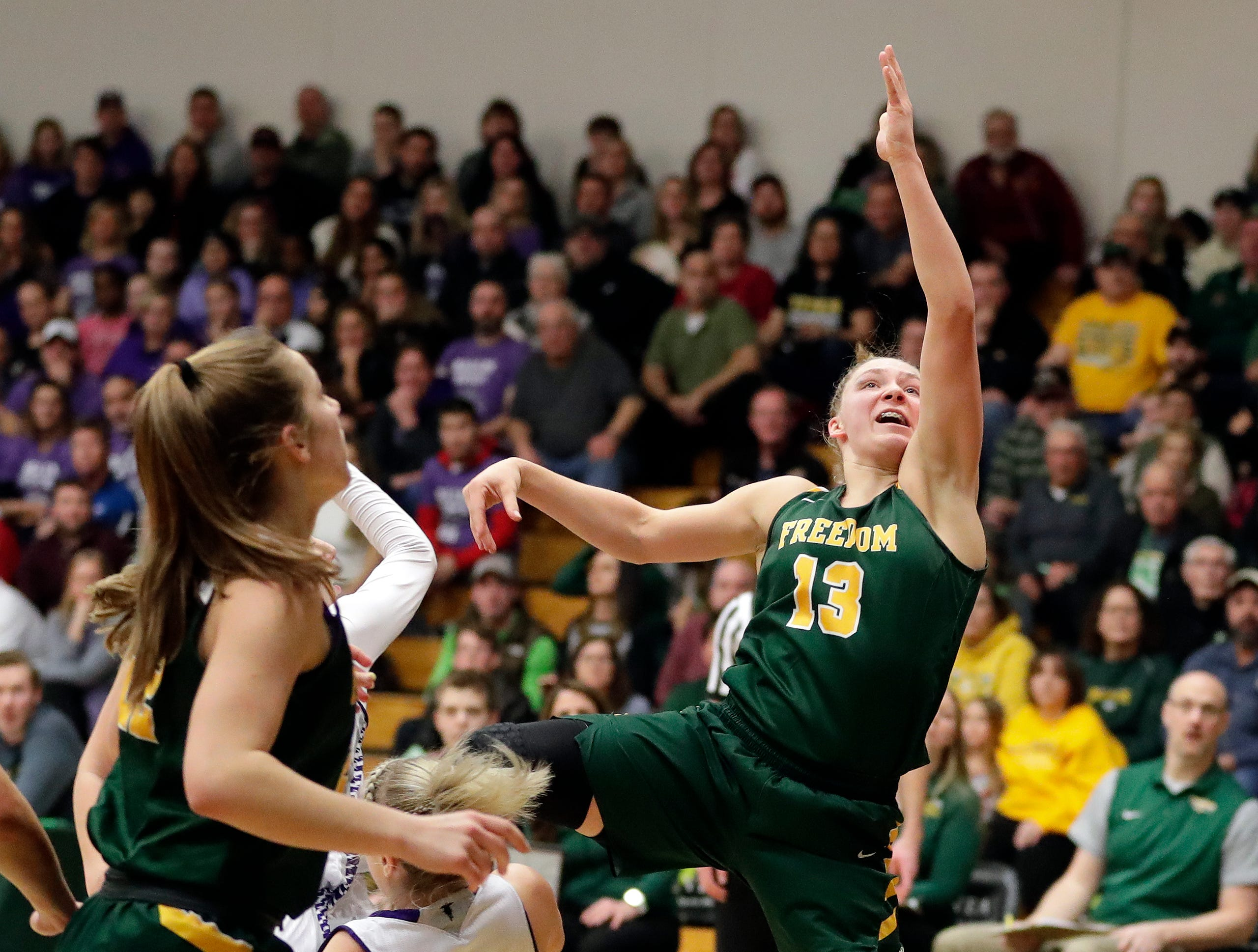 Freedom's Gabby Johnson (13) goes in for a layup during a WIAA Division 3 girls basketball sectional championship against Kiel on March 2, 2019 at Ashwaubenon High School. Freedom defeated Kiel 53-40.