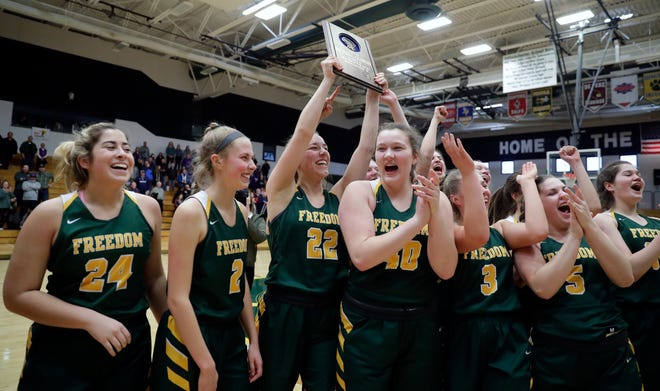 The Freedom girls basketball team celebrates their 53-40 victory over Kiel in a WIAA Division 3 girls basketball sectional championship held March 2, 2019 at Ashwaubenon High School.
