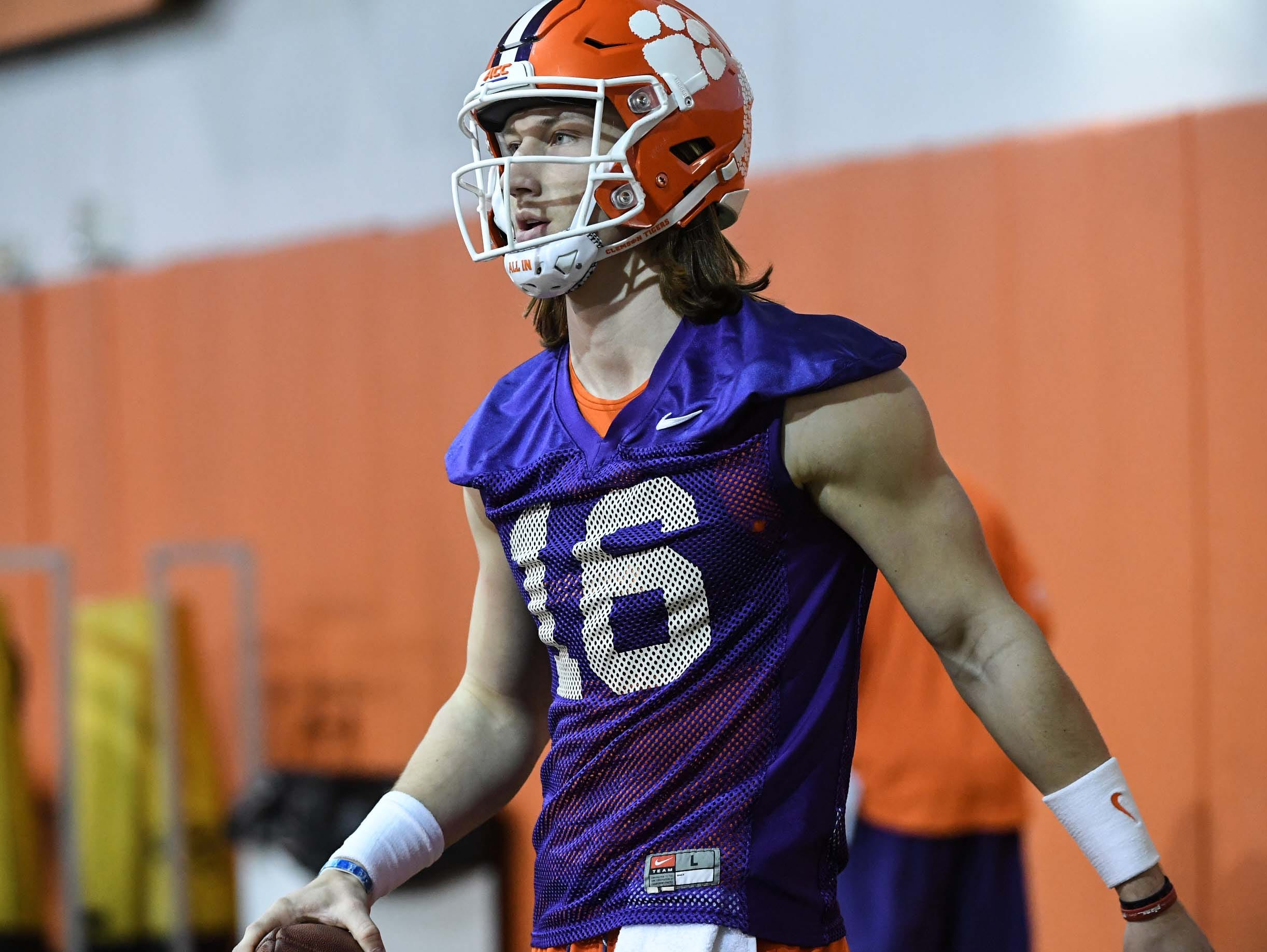Clemson quarterback Trevor Lawrence (16) in drills during practice at the Poe Indoor Facility in Clemson Friday.