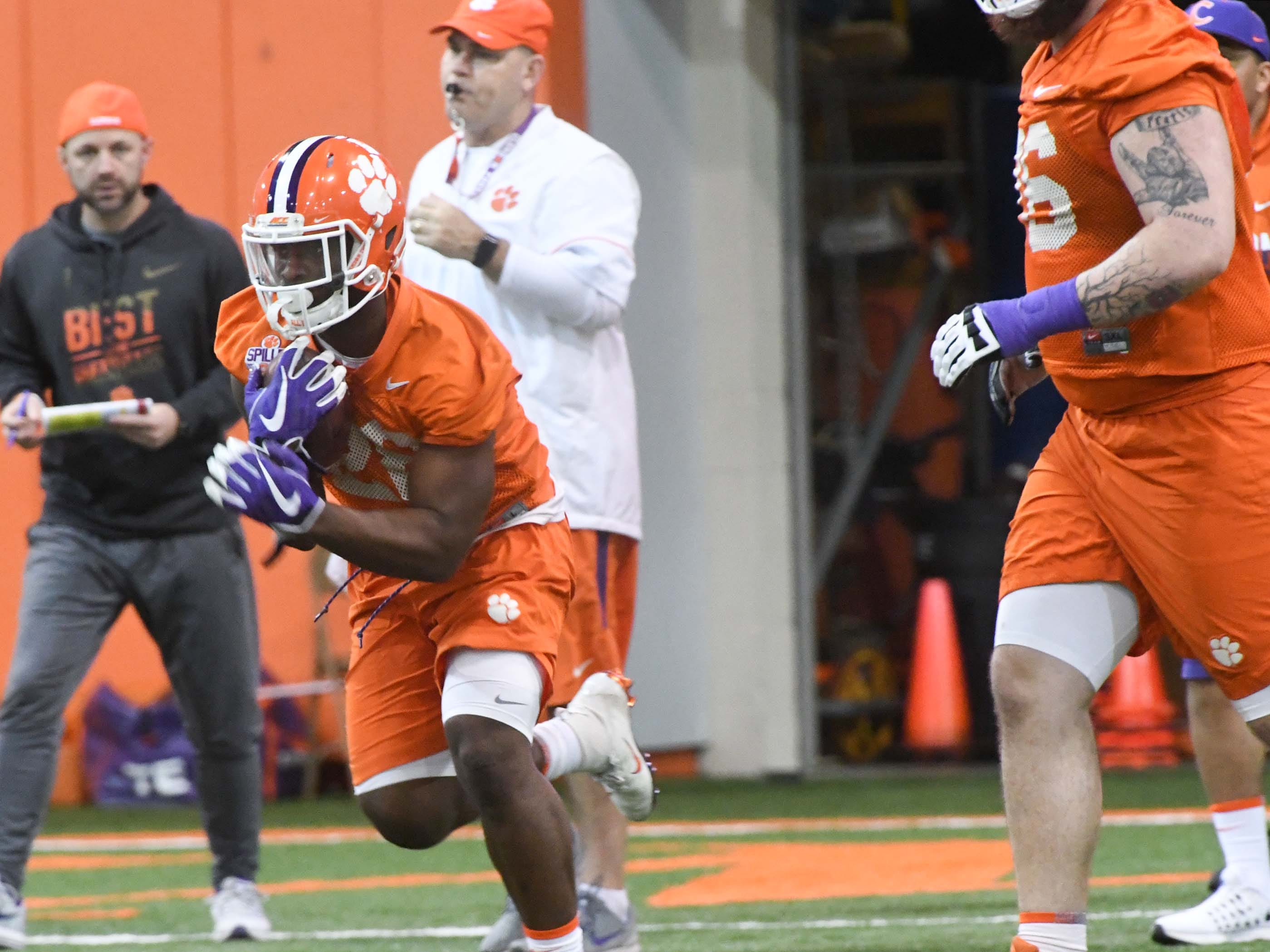 Clemson running back Tavien Feaster (28) runs during practice at the Poe Indoor Facility in Clemson Friday.