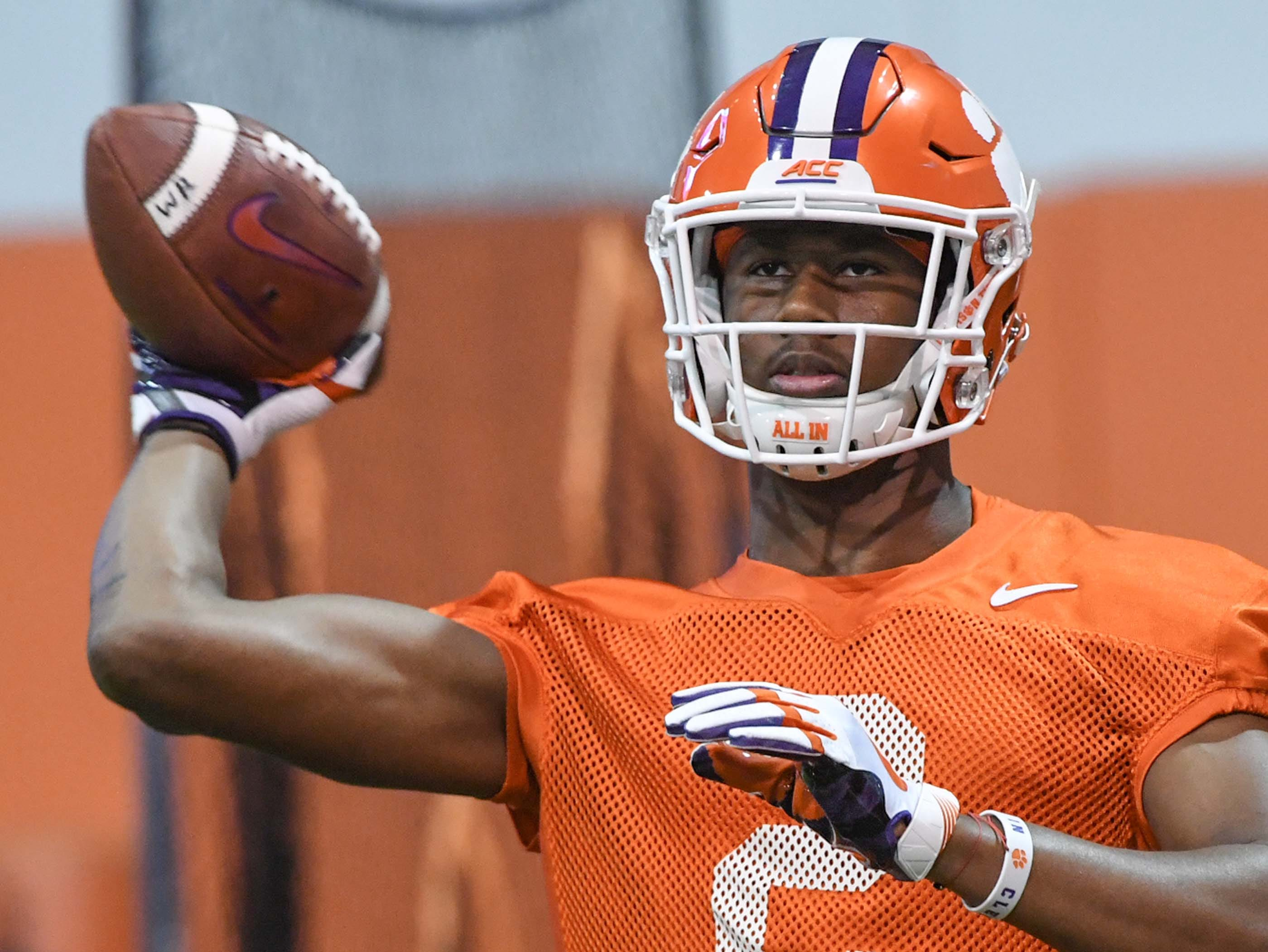 Clemson wide receiver Frank Ladson, Jr. (2) throws a ball during practice at the Poe Indoor Facility in Clemson Friday.