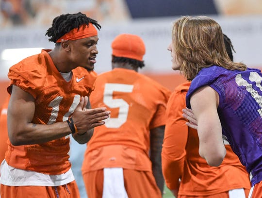 Clemson wide receiver Diondre Overton (14) greets quarterback Trevor Lawrence (16) during practice at the Poe Indoor Facility in Clemson Friday.