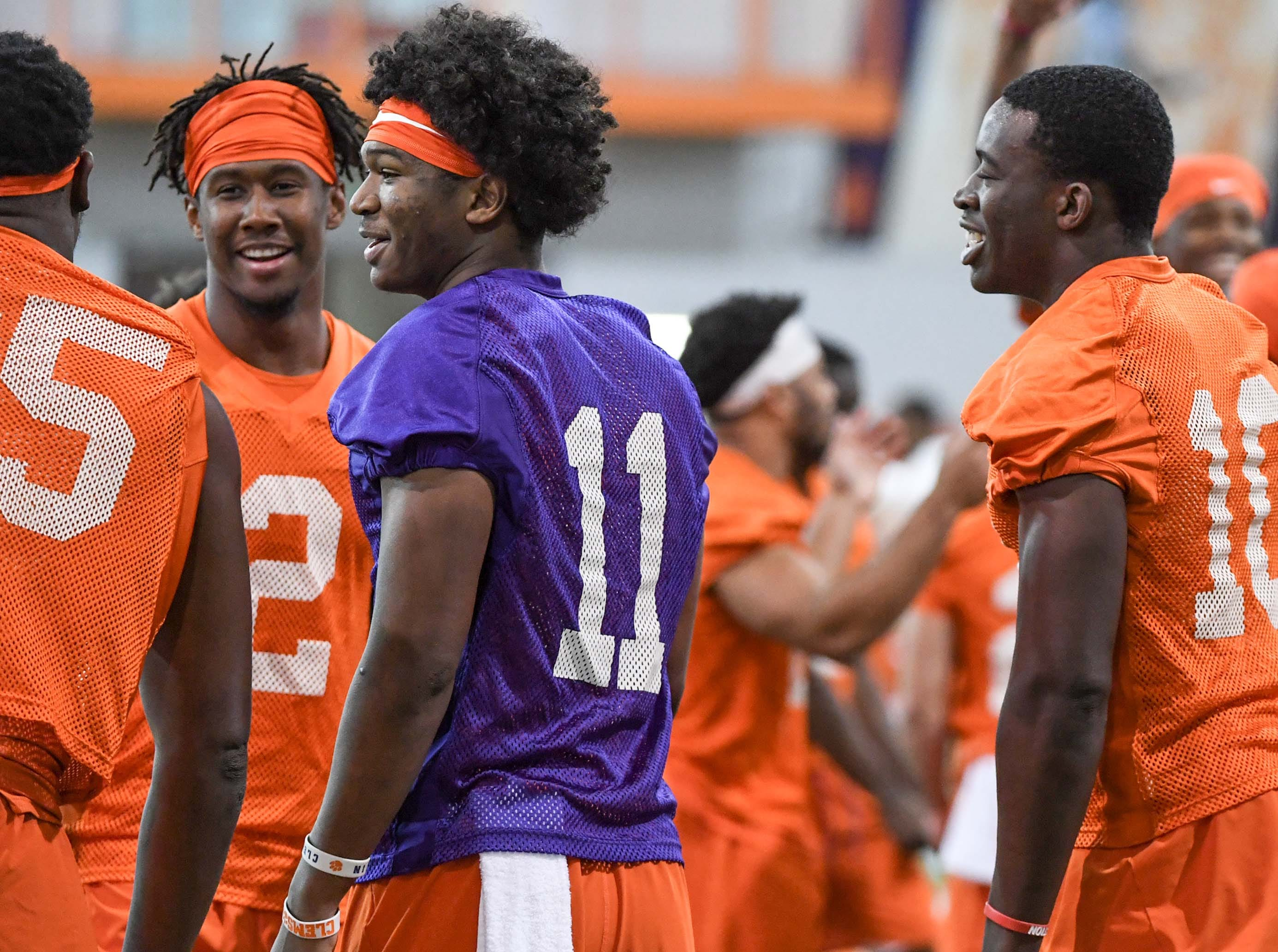 Clemson wide receiver Frank Ladson, Jr. (2), quarterback Taisun Phommachanh(11), and wide receiver Joseph Ngata (10) greet each other during practice at the Poe Indoor Facility in Clemson Friday.