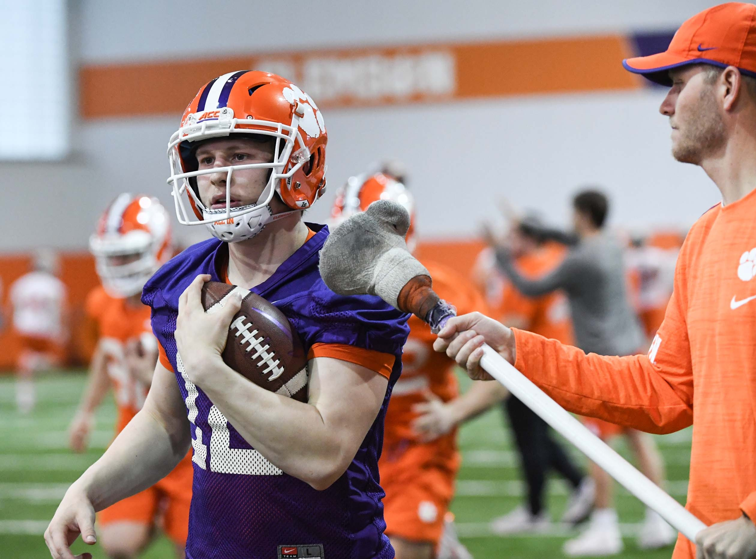 Clemson quarterback Ben Batson runs by quarterbacks coach Brandon Streeter during practice at the Poe Indoor Facility in Clemson Friday.