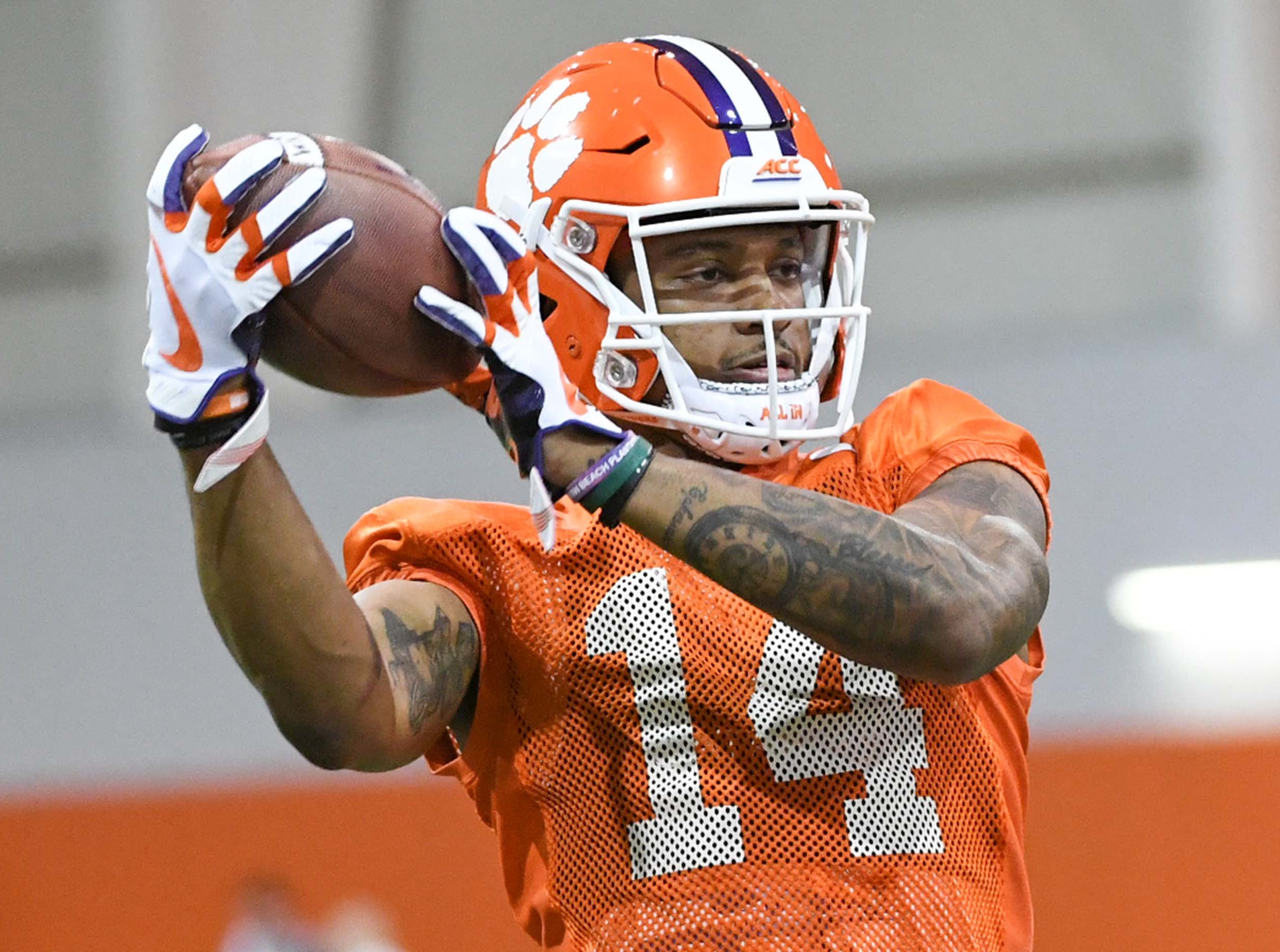 Clemson wide receiver Diondre Overton (14) catches a pass during practice at the Poe Indoor Facility in Clemson Friday.