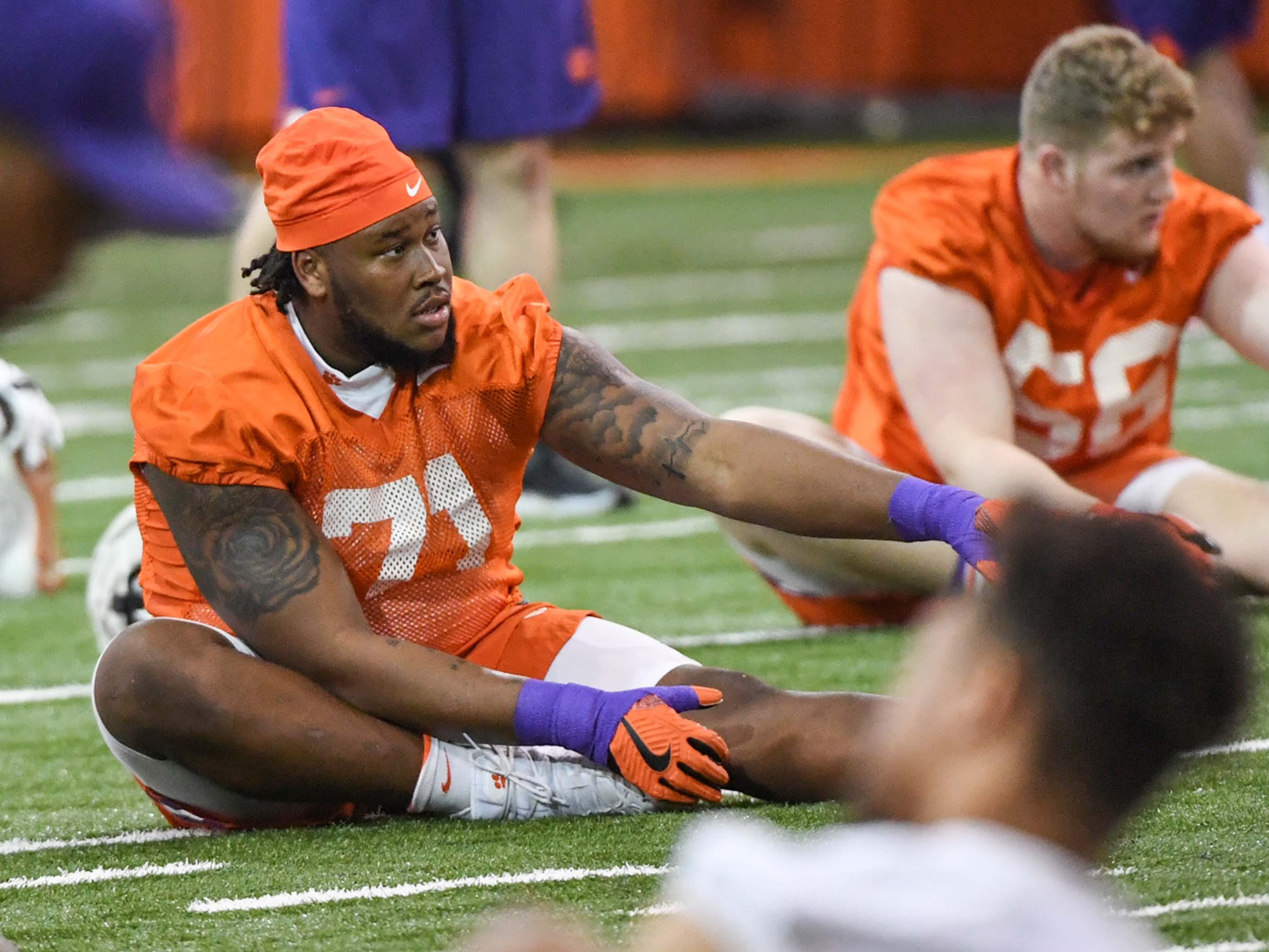Clemson offensive lineman Jordan McFadden (71) stretches during practice at the Poe Indoor Facility in Clemson Friday.