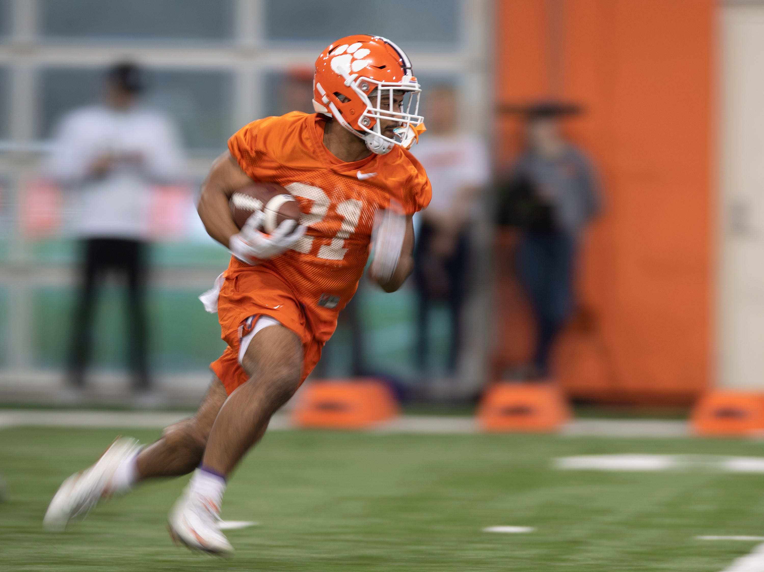 Clemson running back Darien Rencher (21) runs through drills during football practice at the Poe Indoor Football Facility Friday, Mar. 1, 2019.
