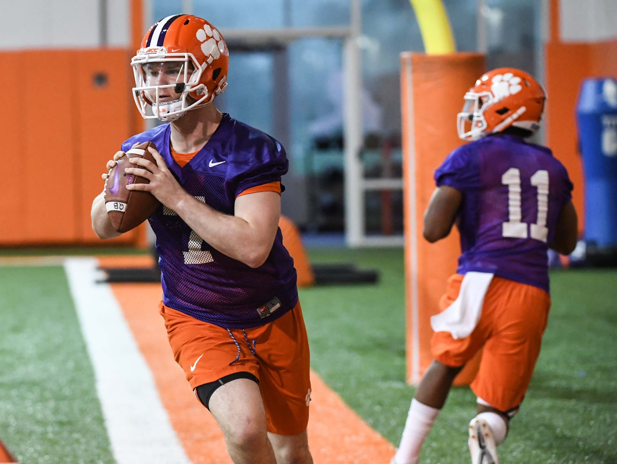 Clemson quarterback Chase Brice (7) and quarterback Taisun Phommachanh(11) in drills during practice at the Poe Indoor Facility in Clemson Friday.