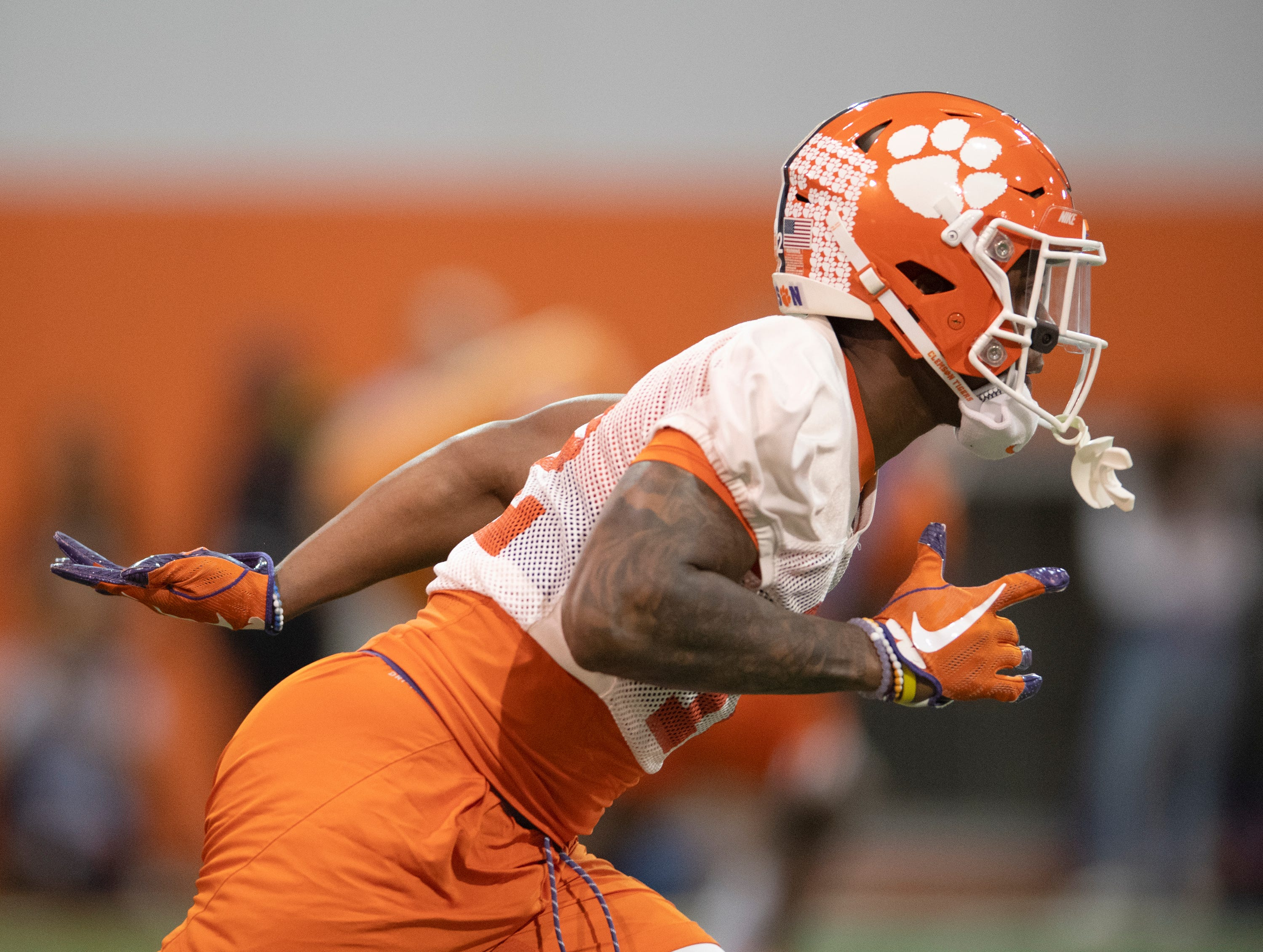 Clemson's K'Von Wallace (12) goes through drills during football practice at the Poe Indoor Football Facility Friday, Mar. 1, 2019.