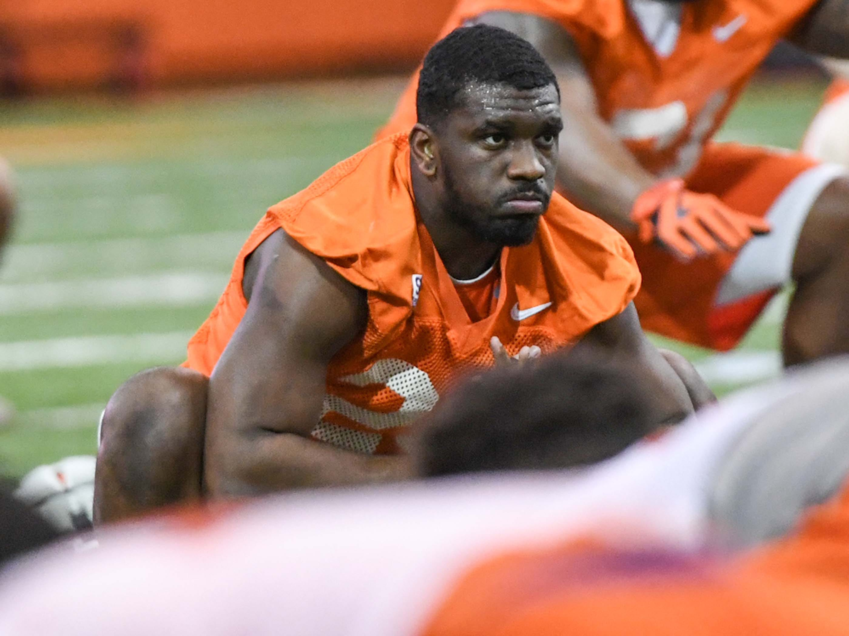 Clemson running back Tavien Feaster (28) stretches during practice at the Poe Indoor Facility in Clemson Friday.