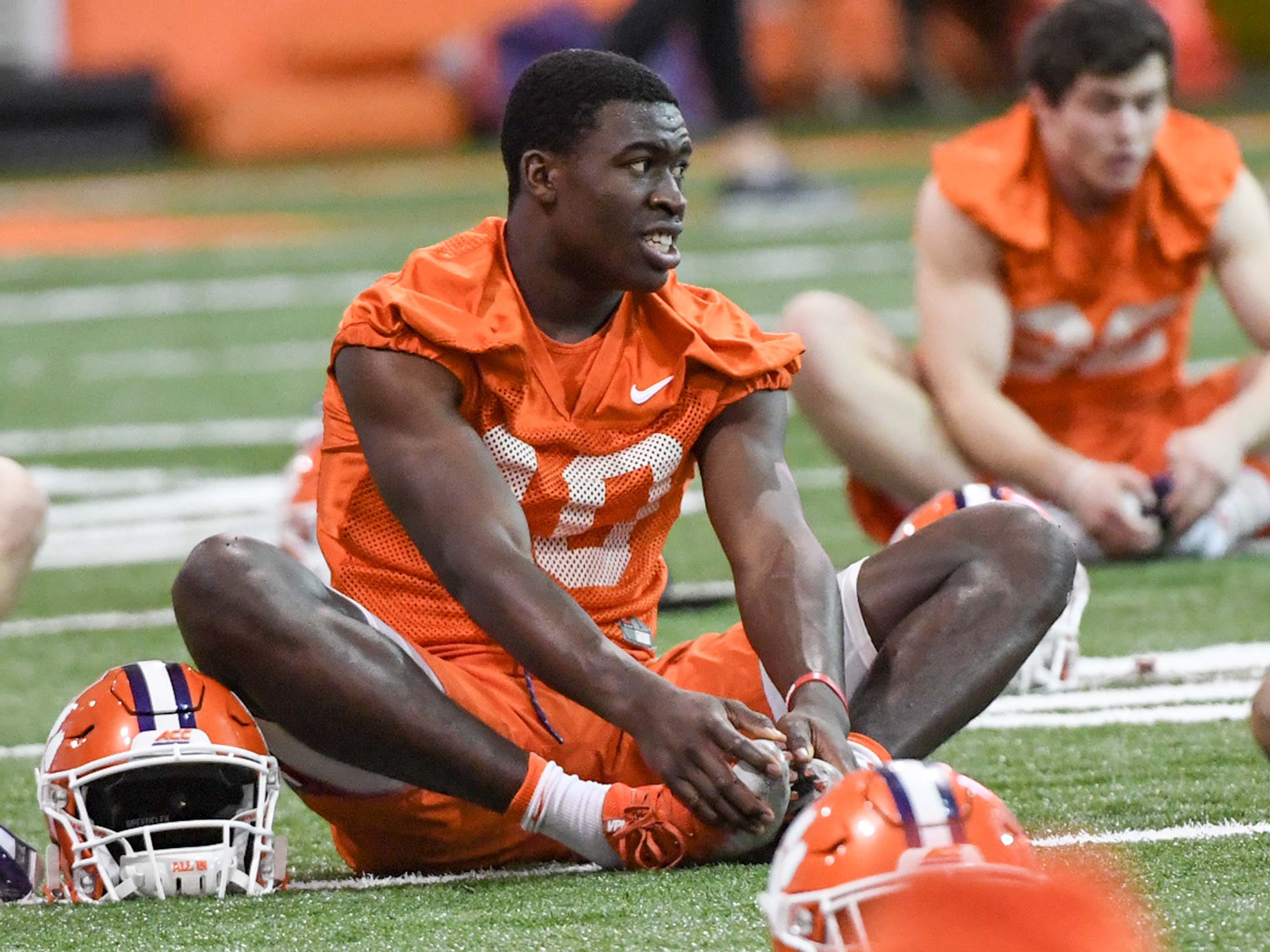 Clemson wide receiver Joseph Ngata (10) stretches during practice at the Poe Indoor Facility in Clemson Friday.
