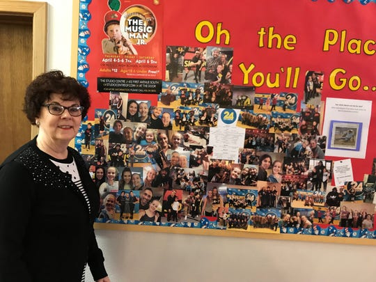 Linda Fuller, owner of Miss Linda's School of Dance, poses by a display of youths currently enrolled in one of her many programs. Her studio is located at 612 1st Ave. South in downtown Great Falls.