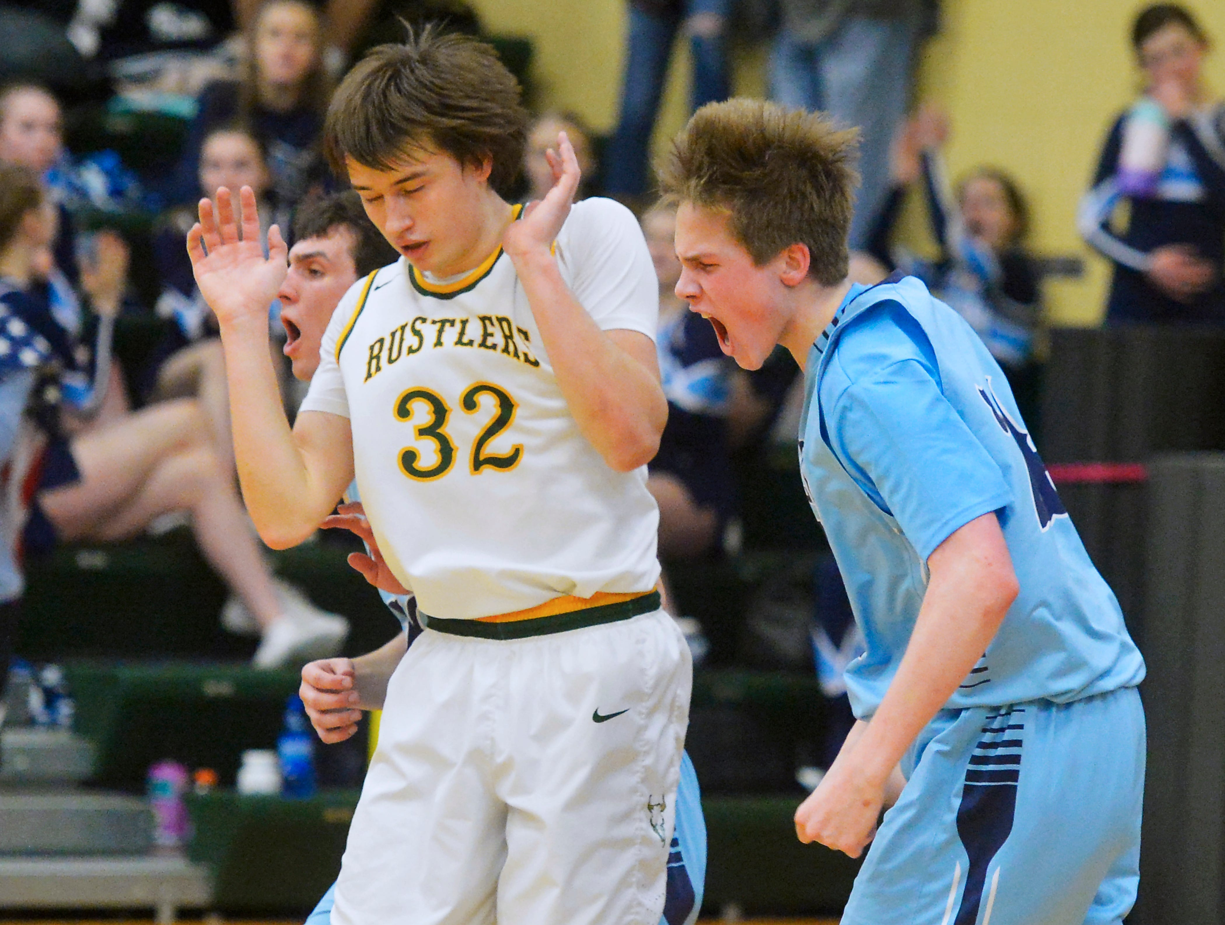 Great Falls High's Drew Wyman celebrates a put back layup during Friday's semifinal game against CMR at the Eastern AA Basketball Tournment in the CMR Fieldhouse.