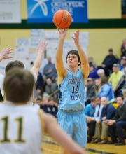 Great Falls High's Blake Thelen shoots a three pointer during the Eastern AA Basketball Tournament semifinal game against CMR, Friday.