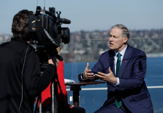 In this March 1, 2019, photo, Washington Gov. Jay Inslee takes part in an interview on an outdoor patio in Seattle. Democrats' growing presidential primary has expanded beyond Capitol Hill and the diverse, women-dominated group of senators that have dominated the race so far. Inslee on Friday became the first governor in the race, and he declared climate change his top priority. (AP Photo/Ted S. Warren)