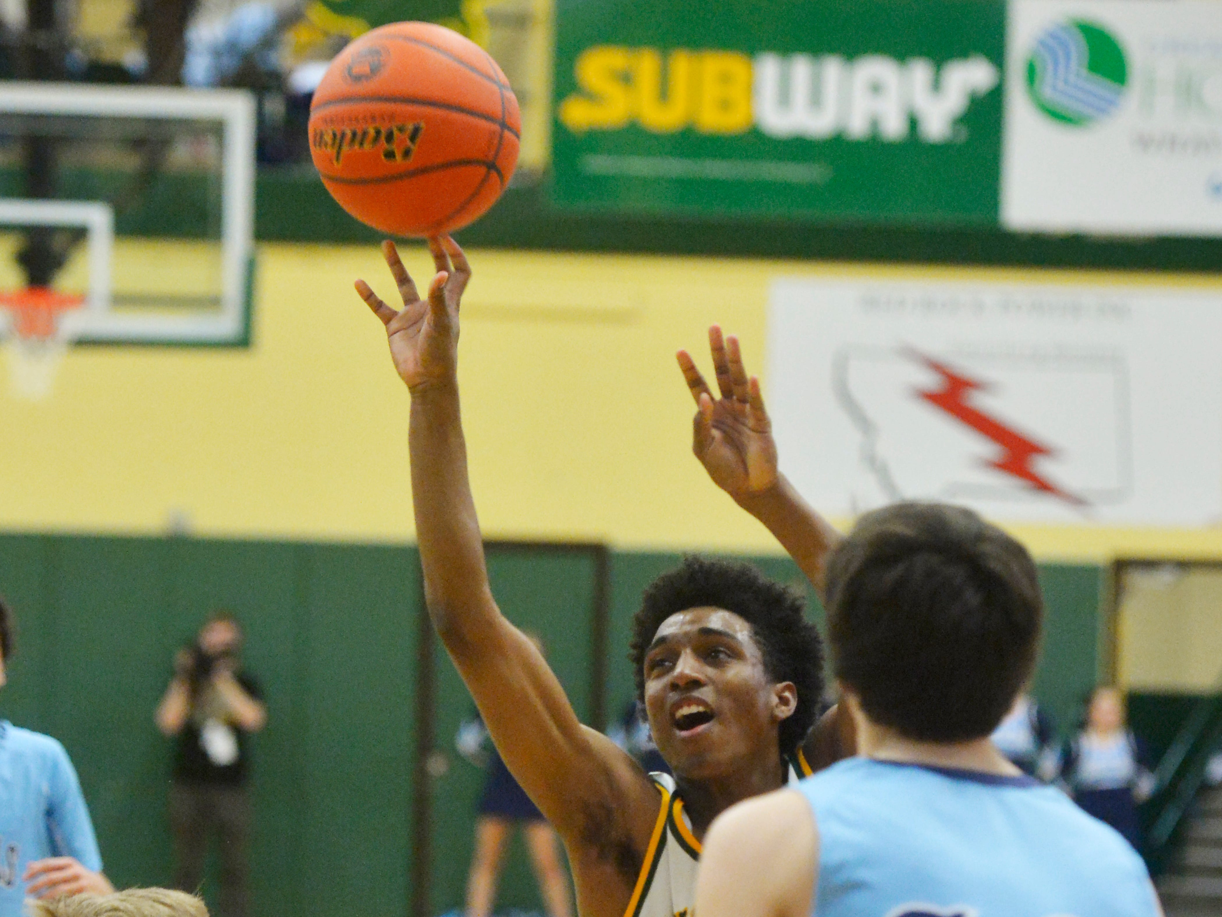 CMR's Caleb Currington attempts a shot during the semifinal game of the Eastern AA Basketball Tournament at the CMR Fieldhouse, Friday.
