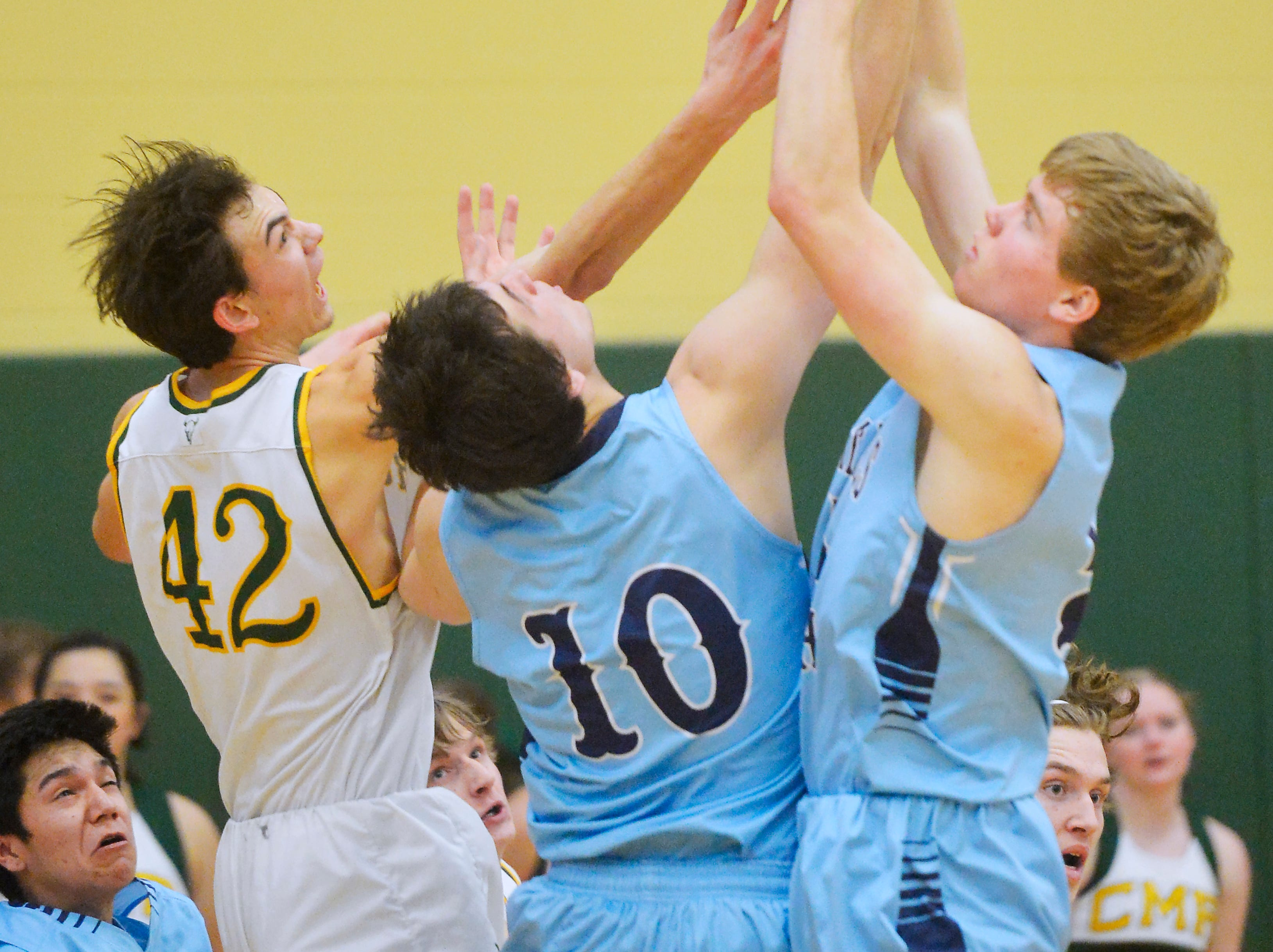Great Falls High and CMR play during the boys semifinal game of the Eastern AA Basketball Tournament at the CMR Fieldhouse, Friday.