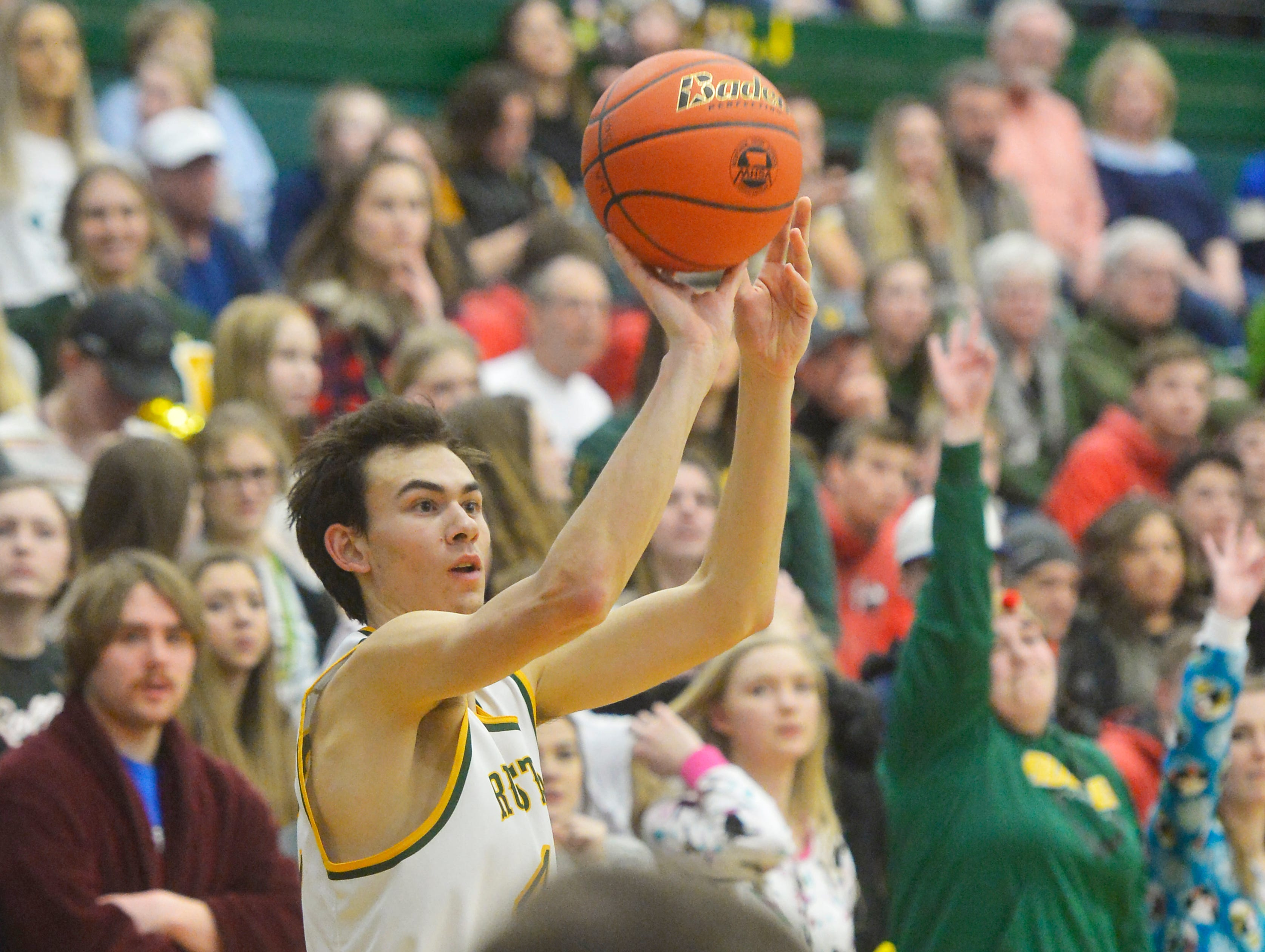 CMR's Russell Gagne shoots during the semifinal game of the Eastern AA Basketball Tournament at the CMR Fieldhouse, Friday.
