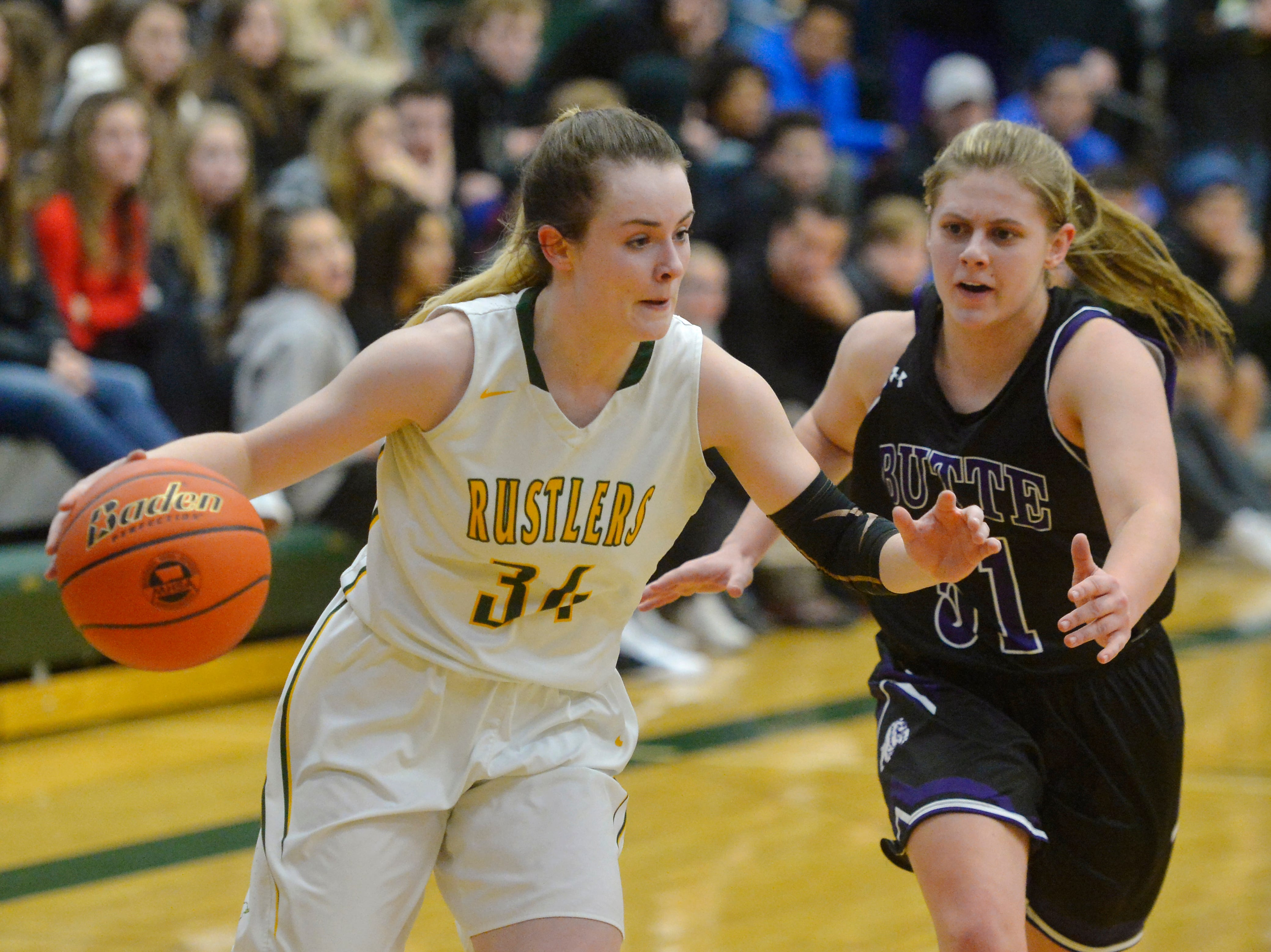 CMR's Kiely Gunderson drives to the basket during the semifinal game of the Eastern AA Basketball Tournament against Butte in the CMR Fieldhouse, Friday.