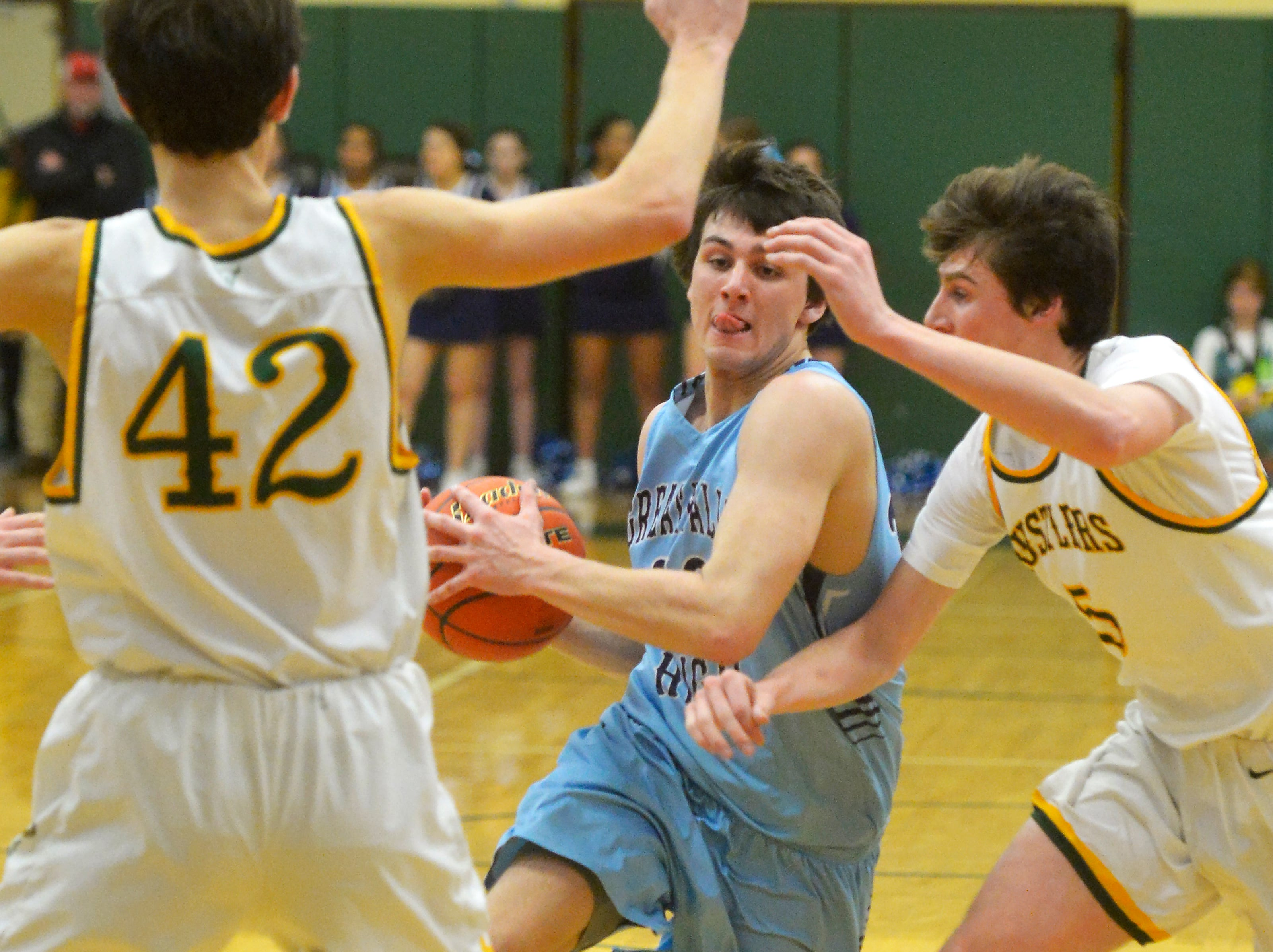 Great Falls High's Blake Thelen drives to the basket during the Eastern AA Basketball Tournament semifinal game against CMR, Friday.
