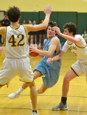 Blake Thelen of Great Falls High drives to the basket against the C.M. Russell High defense during Eastern AA Divisional action at CMR Fieldhouse.