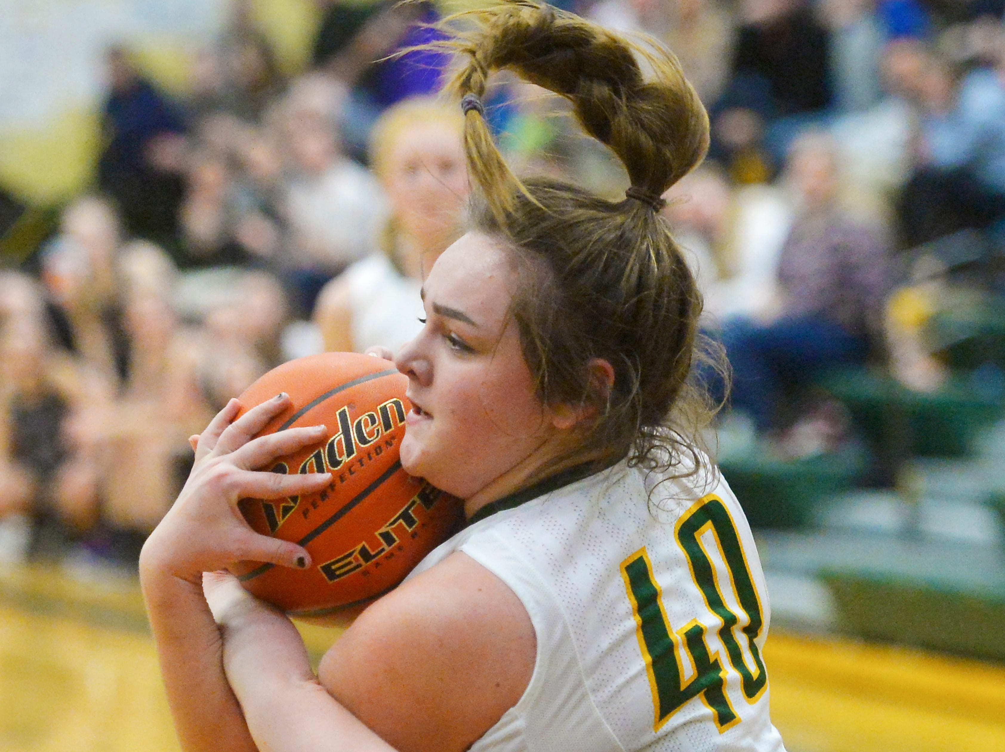 CMR's Marley Calliham hangs on to a rebound during the girls semifinal game of the Eastern AA Basketball Tournament against Butte at the CMR Fieldhouse, Friday.