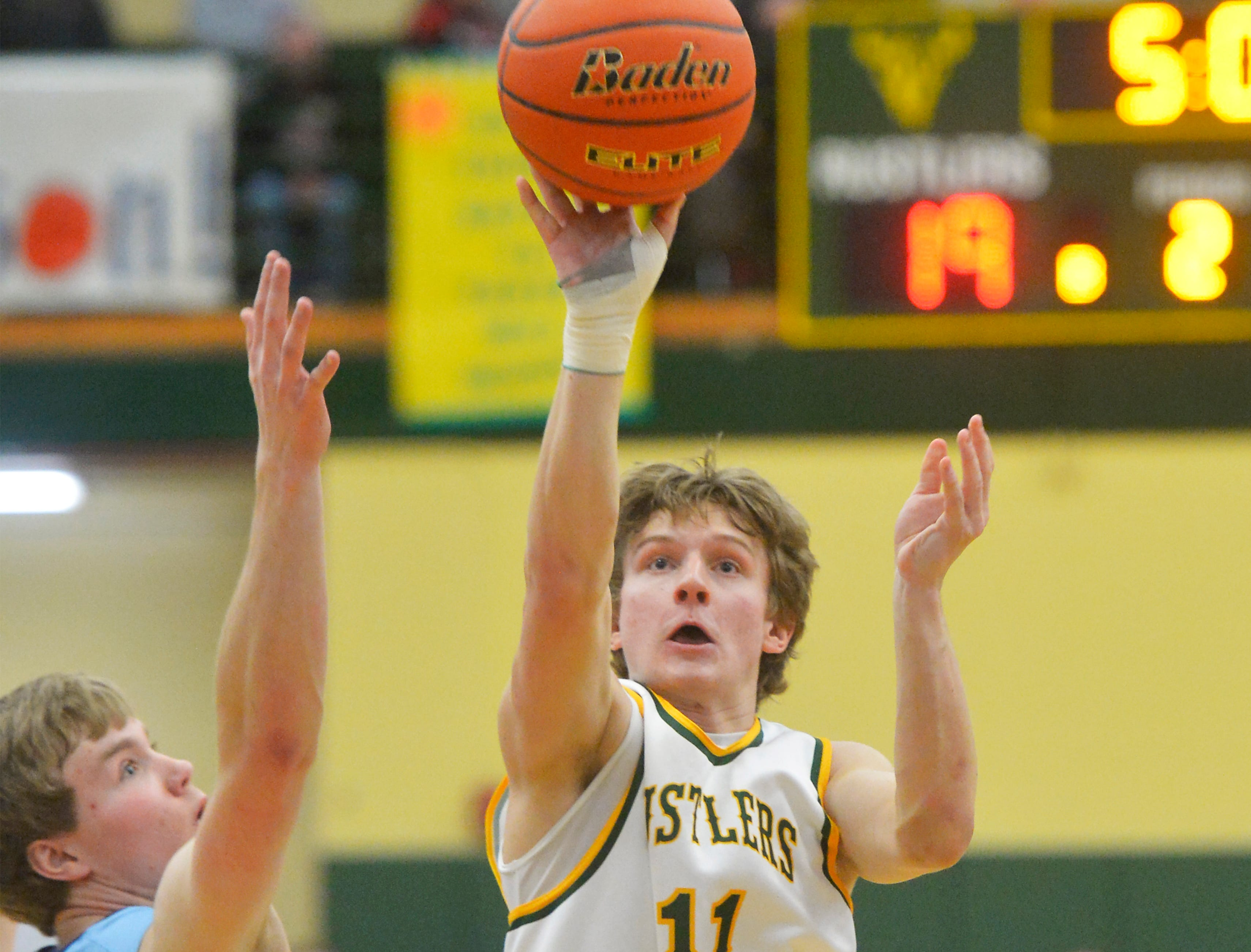 CMR's Cason Taylor attempts a shot during Fridays semifinal game against Great Falls High in the Eastern AA Basketball Tournament at the CMR Fieldhouse.