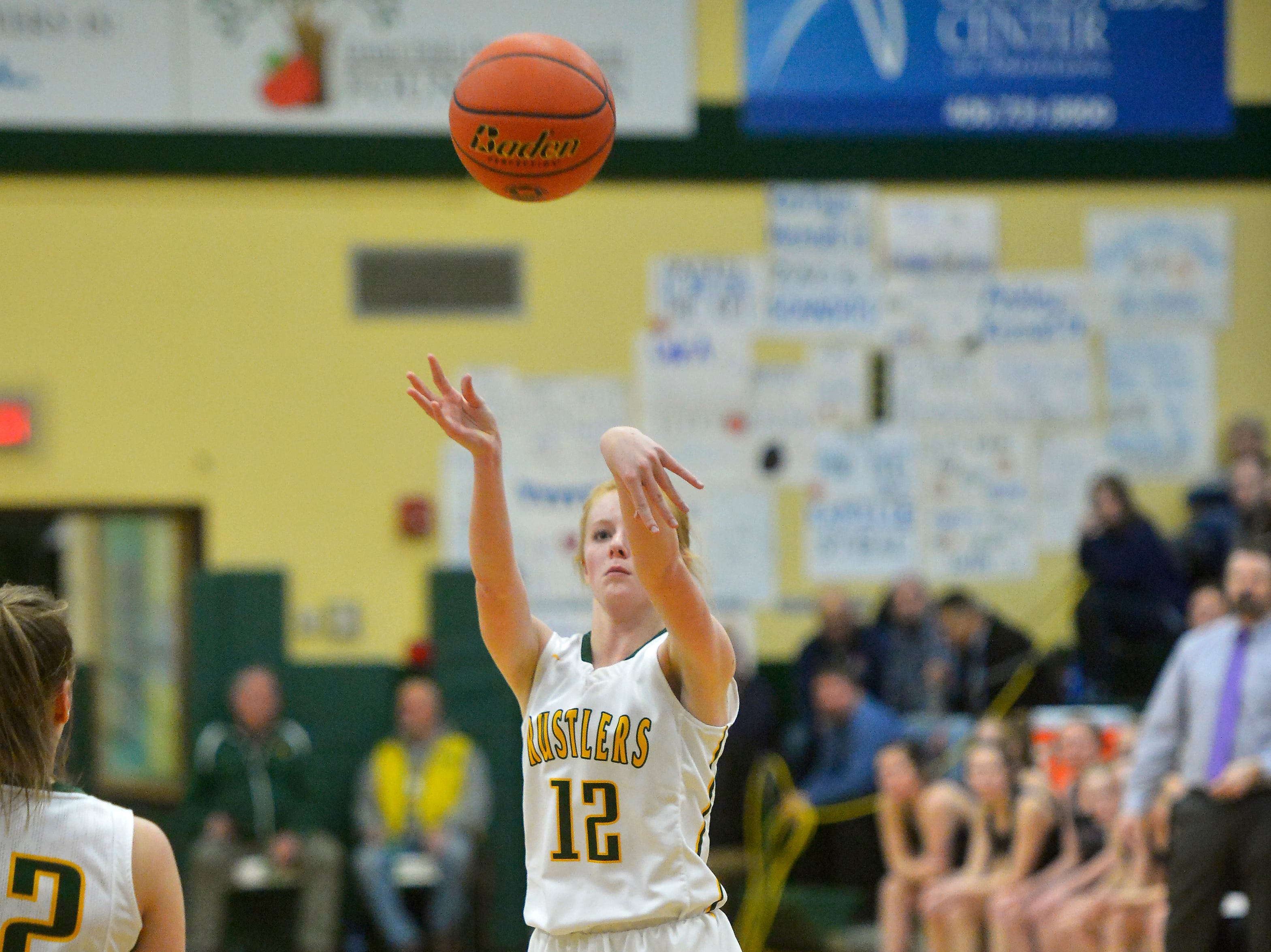 CMR's Emily Funseth shoots a from the outside during the semifinal game of the Eastern AA Basketball Tournament against Butte in the CMR Fieldhouse, Friday.