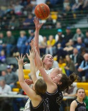 CMR's Allie Olsen attmepts a hook shot over Butte last season.