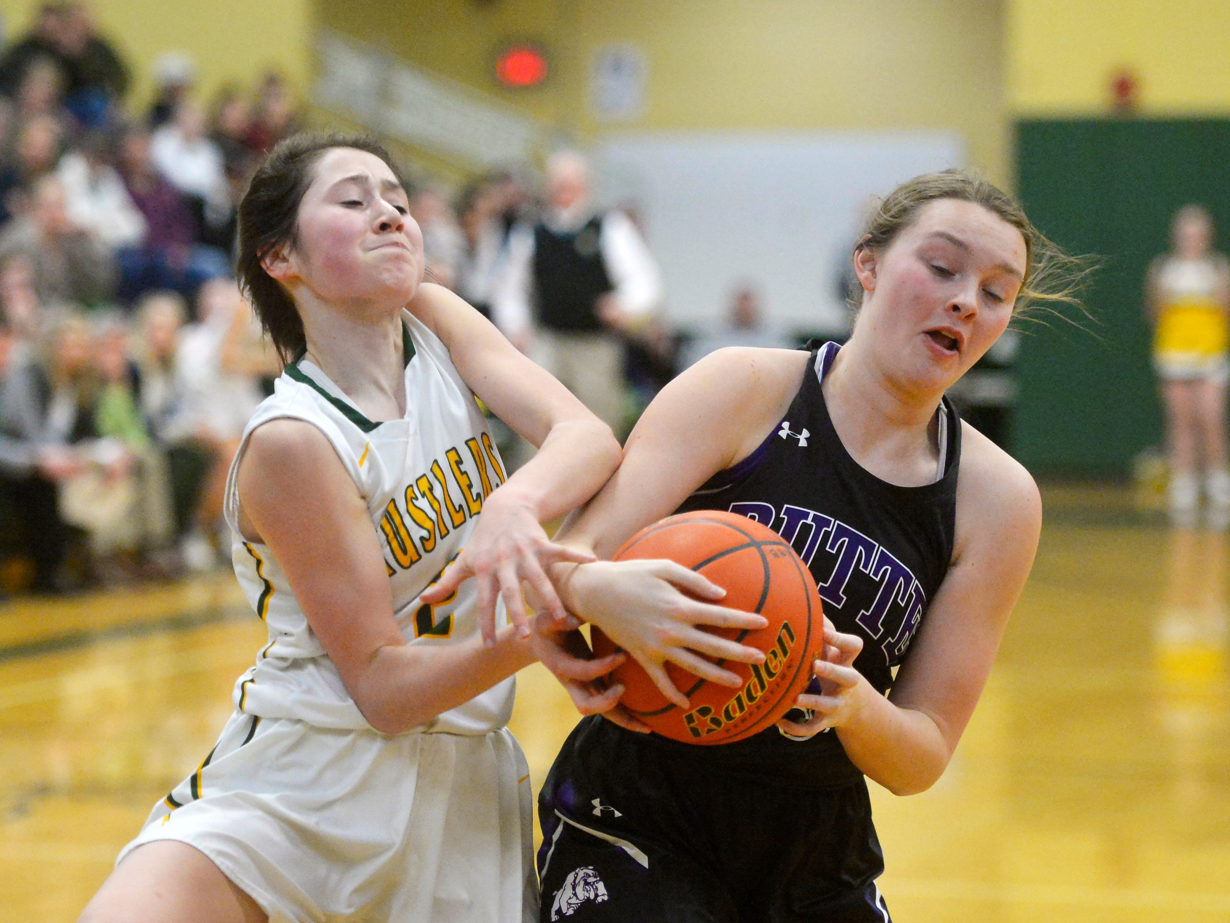 CMR's Lauren Lindseth and Butte's Justise Birkenbuel battle for the ball during the semifinal game of the Eastern AA Basketball Tournament at the CMR Fieldhouse, Friday.