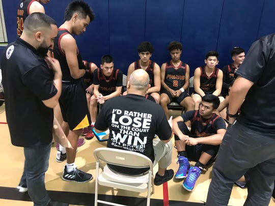 FD coach Eddie Pelkey made a statement with his attire in a game against Guam High March 1.